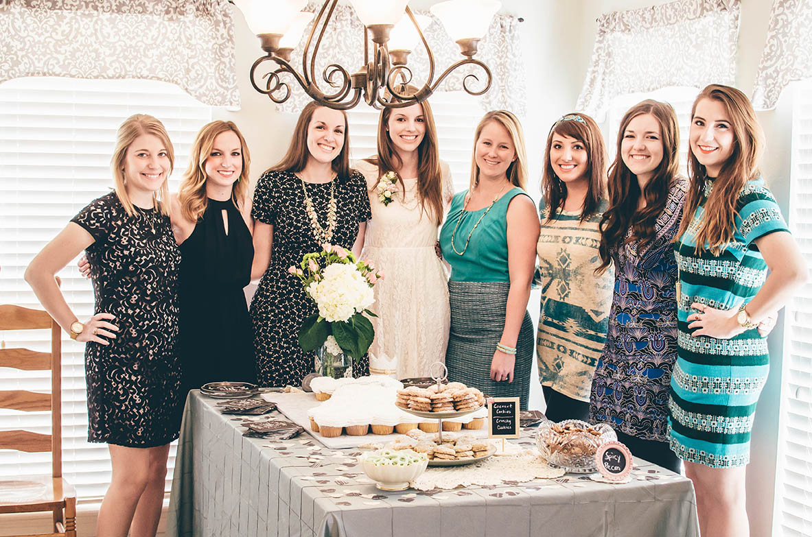 All the bridesmaids, except for one. I actually got to be in a photo for once! Disregard Hannah's tallness interfering with the light fixture...