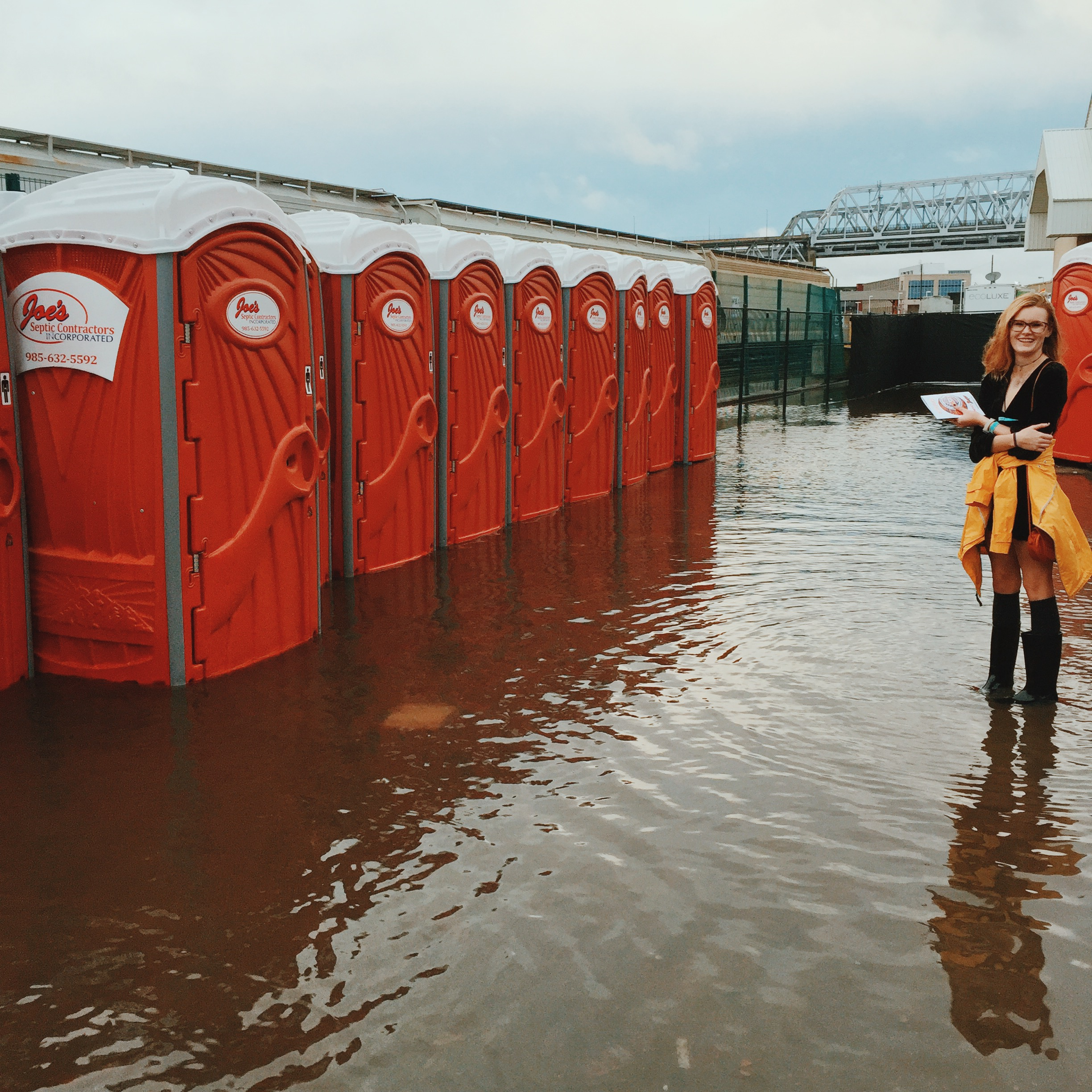 My friend Darby waiting to use a bathroom. New Orleans was pretty flooded from all the rain. This was real nasty.
