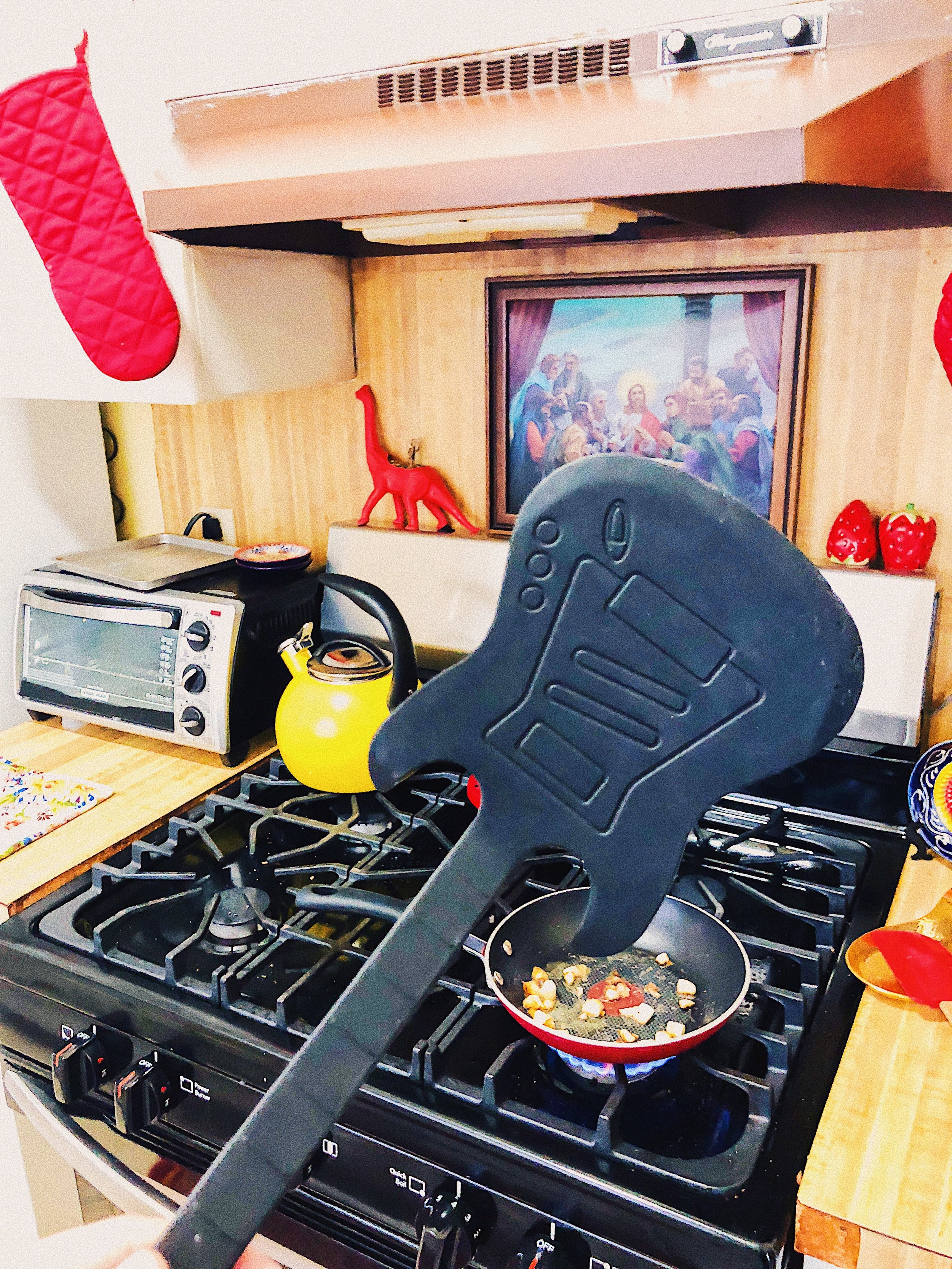 This guitar spatula cracks me up every time I use it. Also available in red!