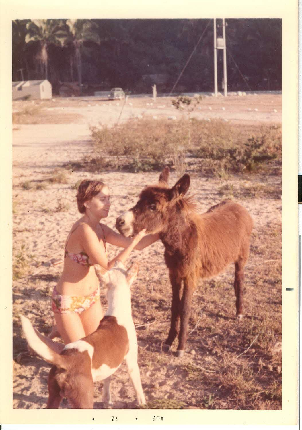 Young and lithe in 1972 on Mismaloya beach near Puerto Vallarta communing with a cute donkey and stray dog.
