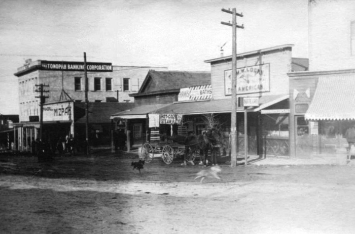 "Tom Logan's saloon, ""The American,"" Main Street and Brougher Avenue, Tonopah, Nevada - c. 1905"