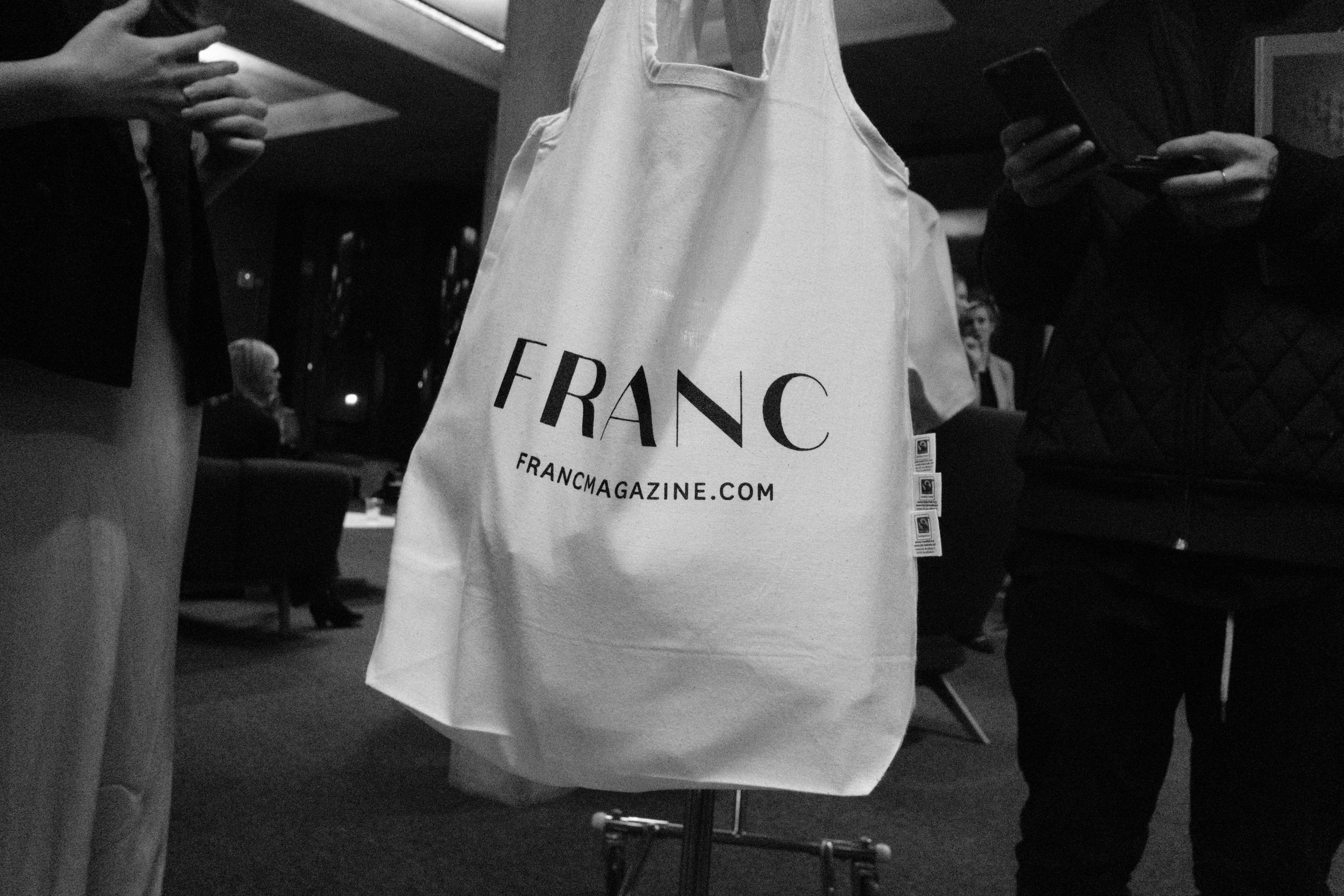 tote bag buying phone.JPG