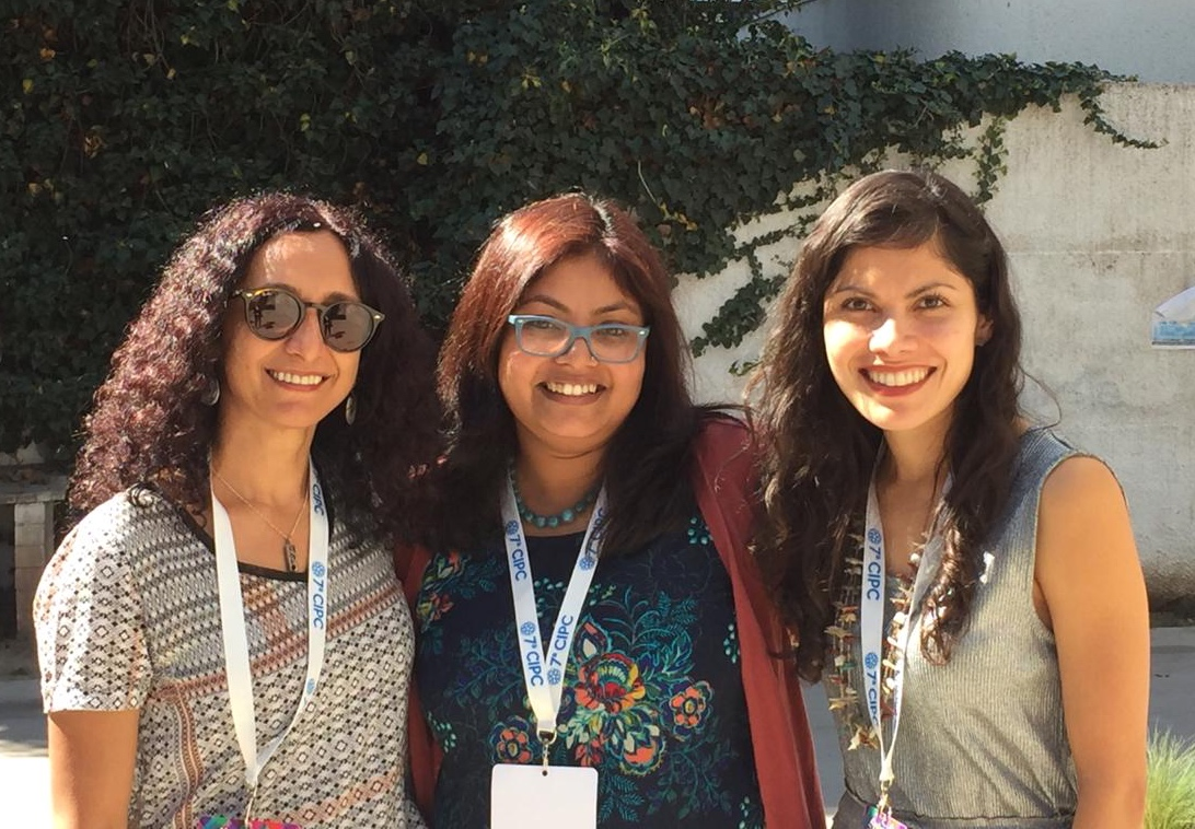 """With Shahnaaz Suffla and Jesica Fernandez, co-panelists on the session """"Troubling and Reflecting Upon Decoloniality: (Re)Imagining a Community Psychology from the Global South"""" at the 2018 ICCP in Chile"""