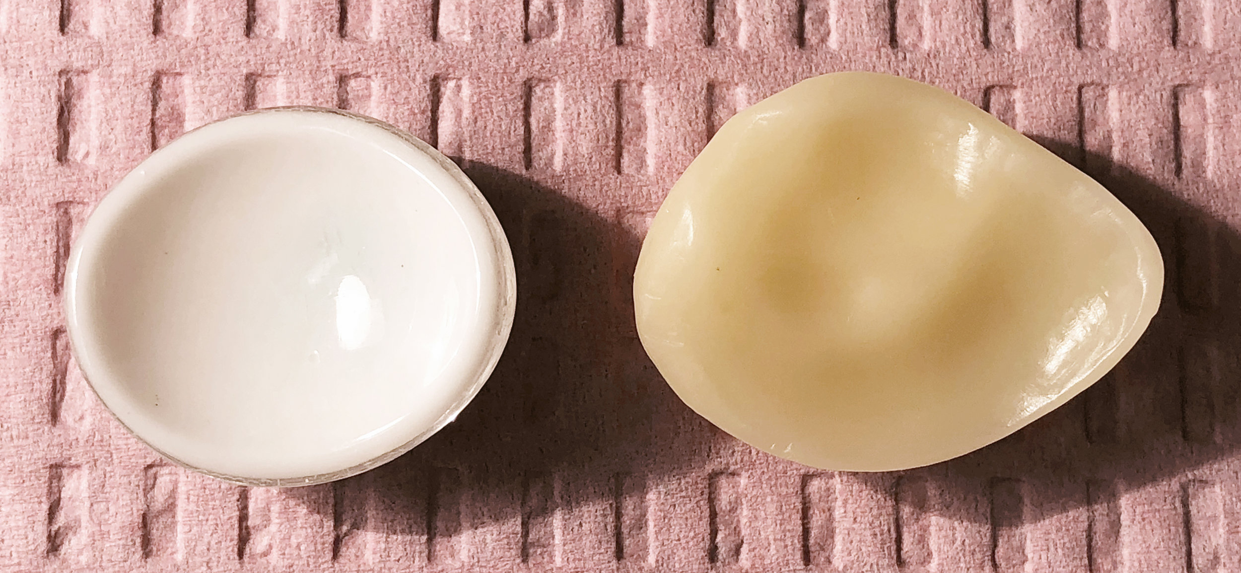 A side by side comparison of the posterior side of the stock eye vs. the custom fitted prosthesis. The shape of the prosthesis is shown in a wax model, to be cast later into the final prosthesis.