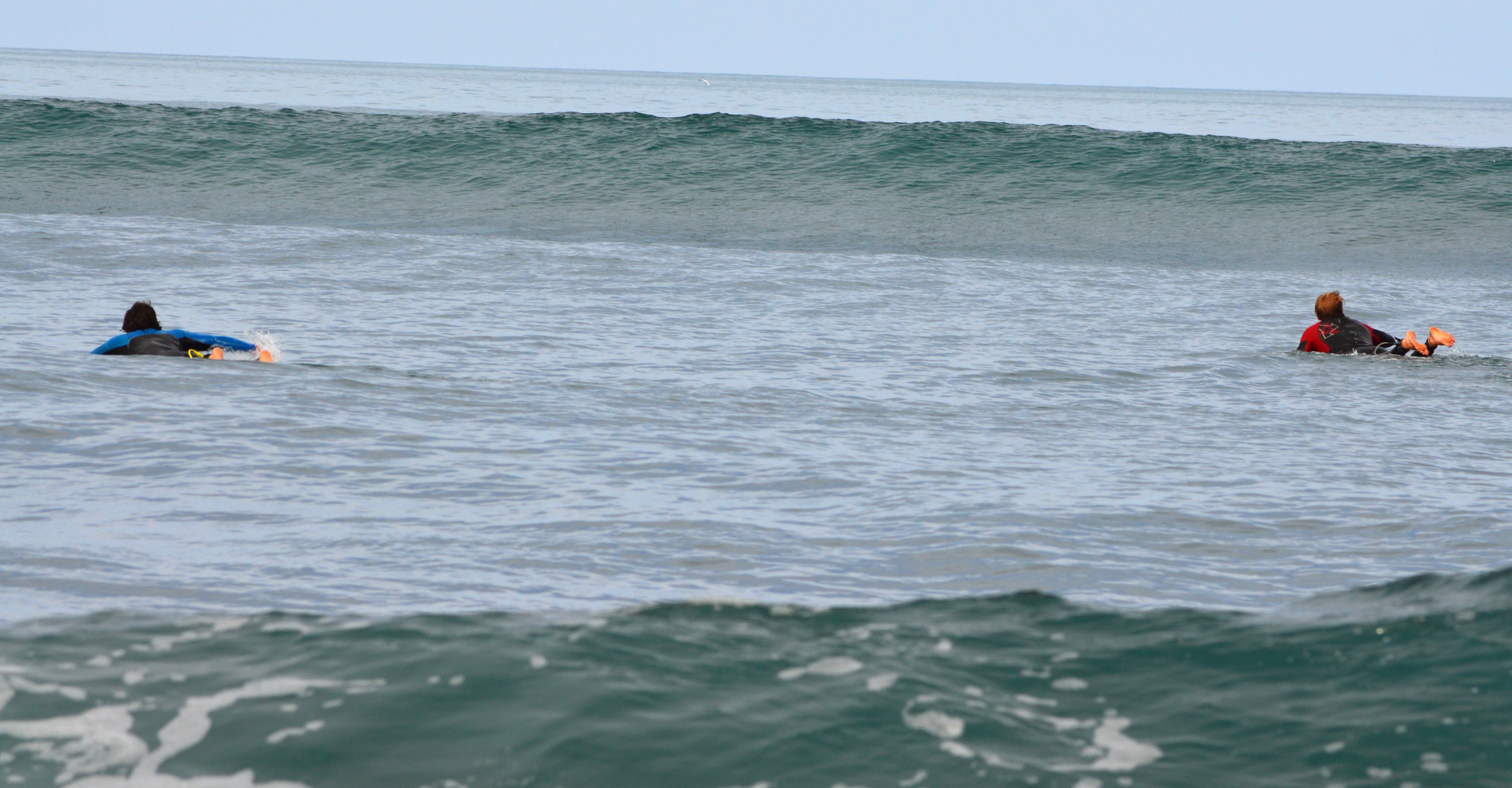 Paddling out into an empty lineup Photo@bossemarcus. Surfer left@crippoo