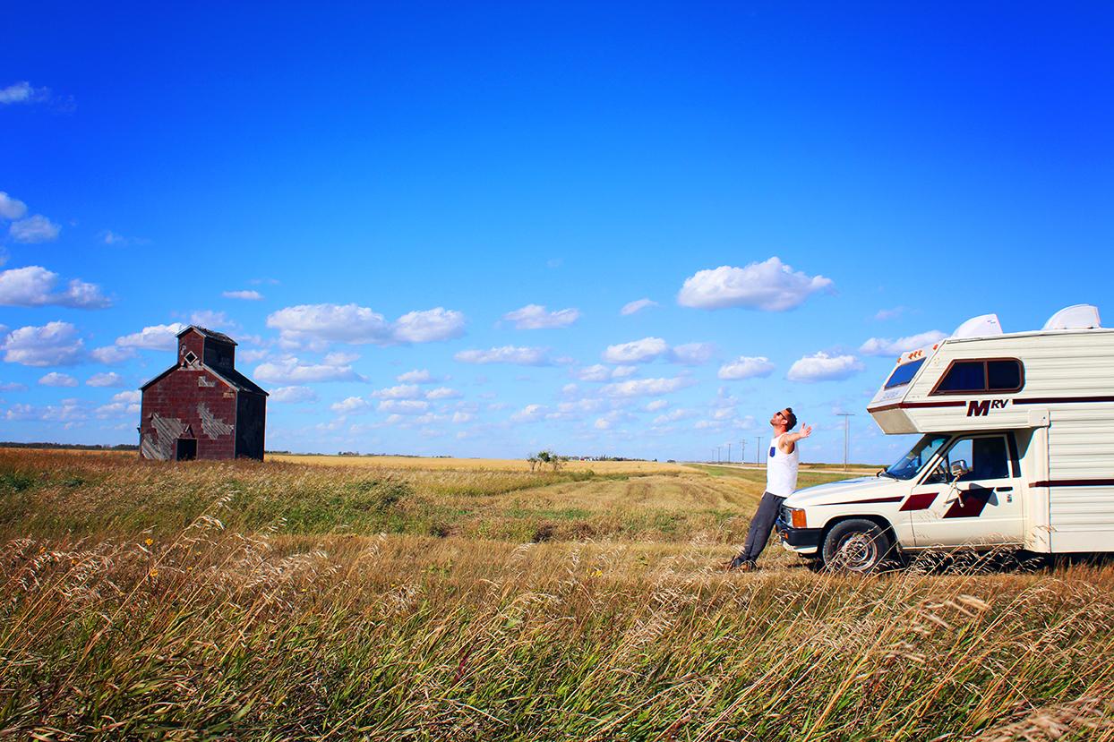 In a yellow field under a clear blue sky somewhere in Saskatchewan