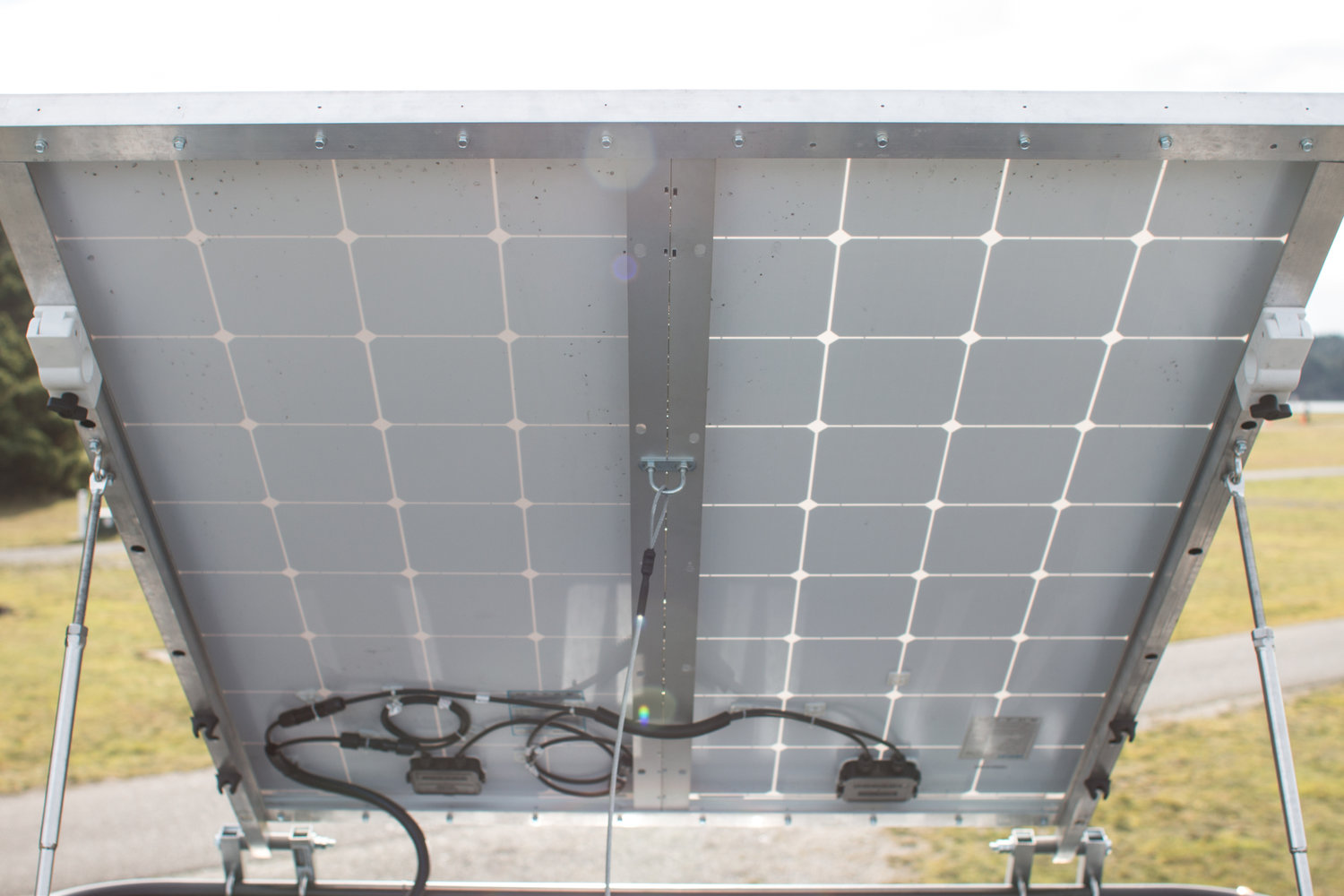The two solar panels are fixed together with some custom framing, making it effectively one giant solar panel. Thanks to our roof rack we could do the two panels lengthwise along the van, which optimized our space.