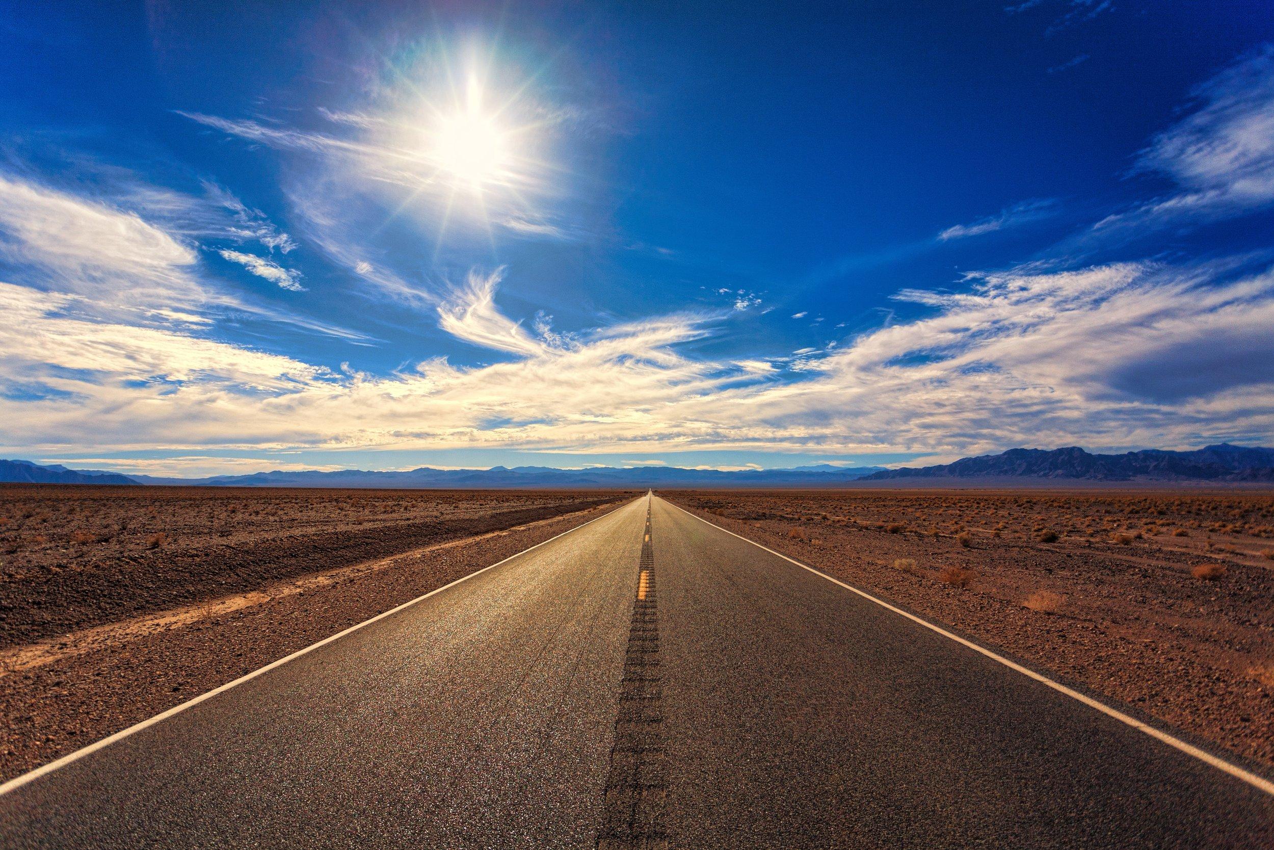 asphalt-blue-clouds-1133505.jpg
