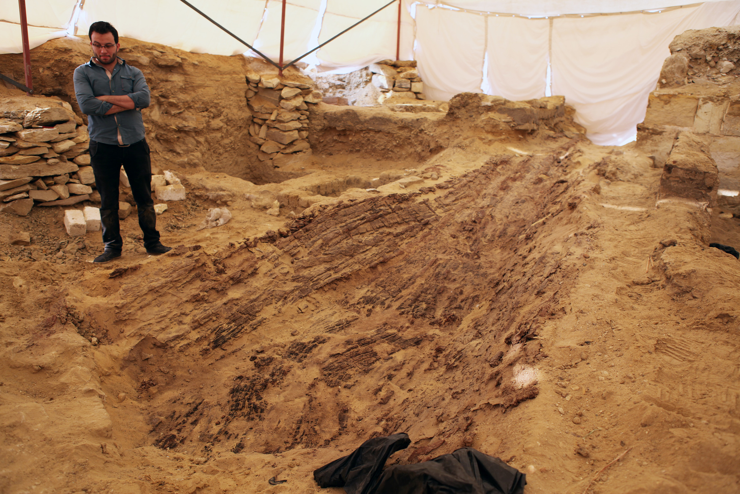 This photo was taken on November 8, 2015 during the excavation and restoration of the Old Kingdom boat. (c) Czech Institute of Egyptology / V. Dulikova.