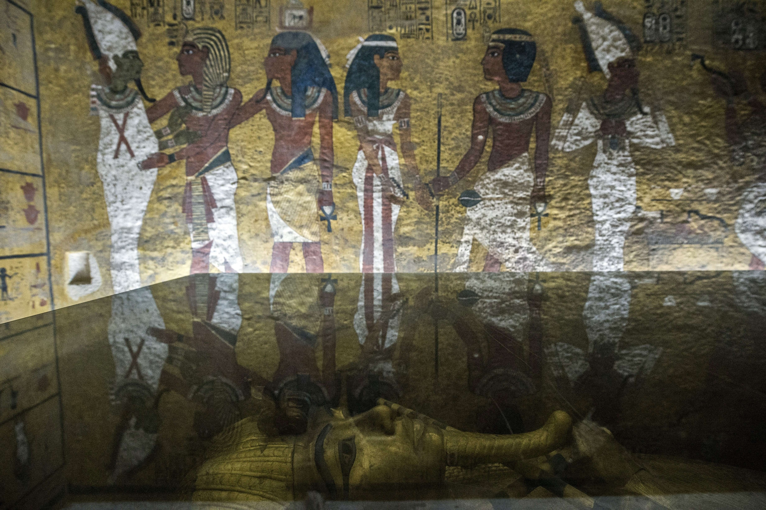 Pictured is the outermost of Tutankhamun's three coffins that cocooned the young king for over 3,000 years. Nicholas Reeves believes that the right-side of the wall in the background is largely false, designed to foil tomb robbers and protect whatever lies beyond. Photo: Khaled Desouki.