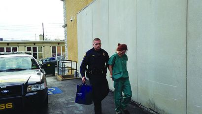 Woman is charged with assault for throwing blood on a nurse