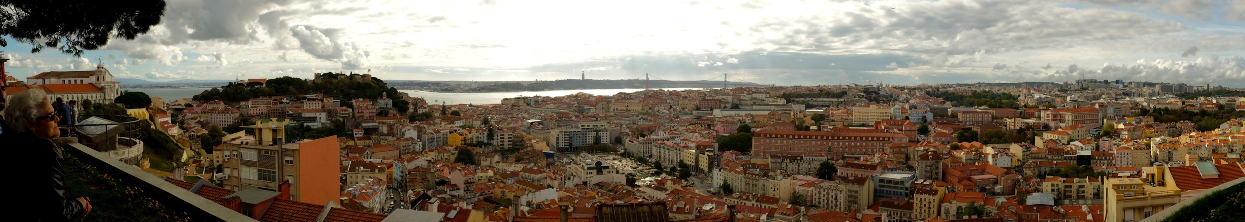 Lisbon cityscape from a viewpoint -in the distance you can see the 'Puente 25 de abril' bridge that looks a bit like Golden Gate bridge in San Francisco. Click to enlarge.