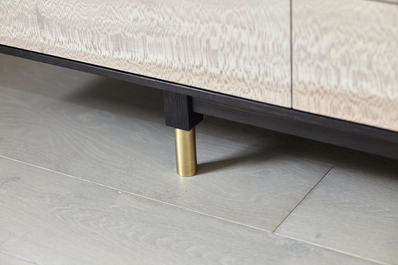 Adjustable brass cabinet foot.jpg