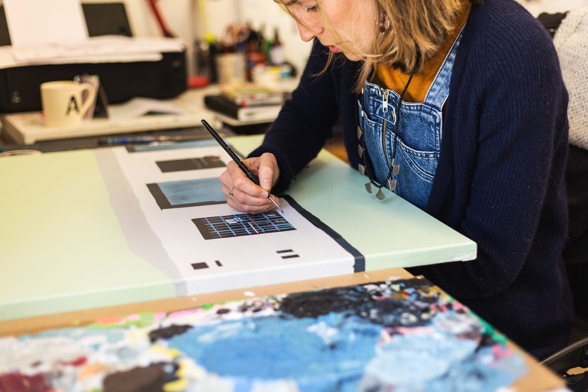 - b. 1983, ManchesterAnnie lives in Bristol and works from Jamaica Street Studio's in the creative heart of the city. She studied Textile design at Brighton University, leaving in 2005 with a 1st class BA degree. Annie has been working for over 13 years as a printed textile designer for many clients, but recently has been led to explore more deeply the environment around her and her relationship with the city; community and perspectives through painting.Annie currently works with acrylic and decorating emulsion, collage and spraypaints to convey objects and places as she believes them to be. Colour, shape and texture are built to create scenes on canvas.