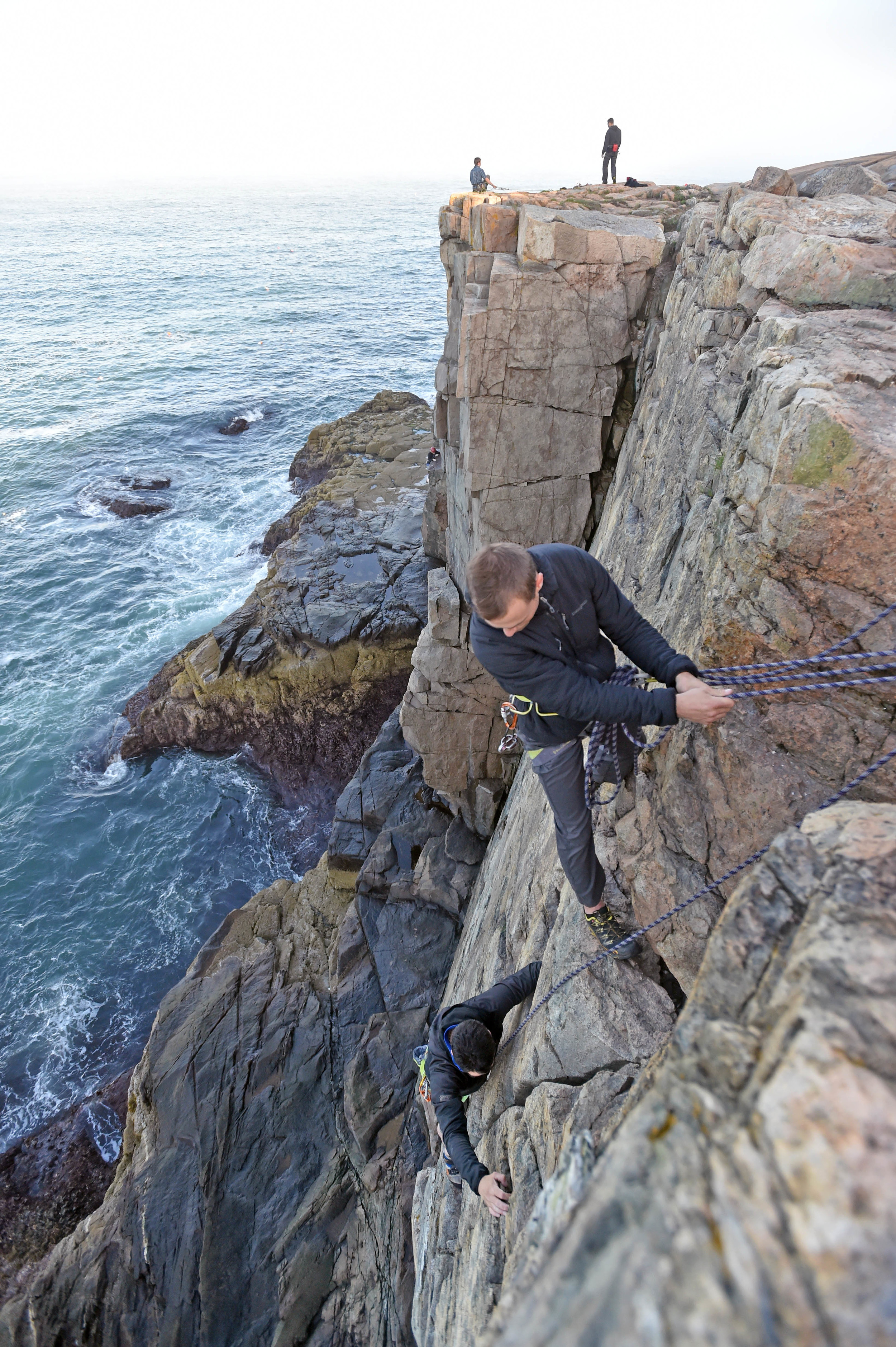 Ryan Howes rock climbing with a client in Acadia National Park off the coast of Maine.      photo credit: Michael Seaman