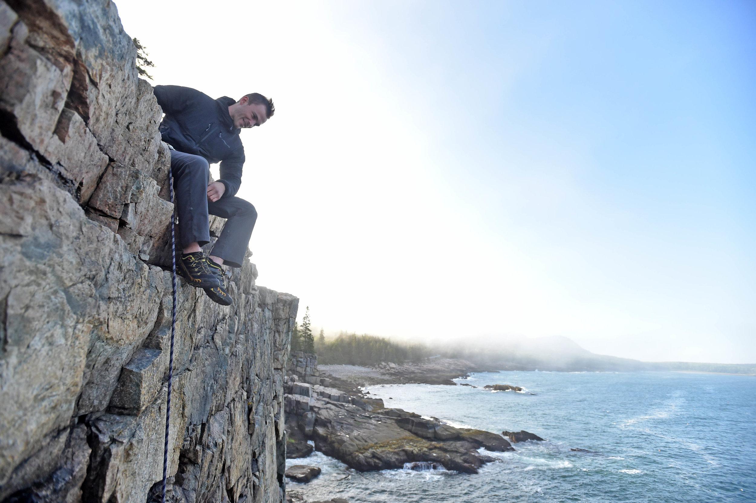 Ryan Howes belays his guest while enjoying coastal Maine's splendid summer environment.  Photo by Michael G. Seamans