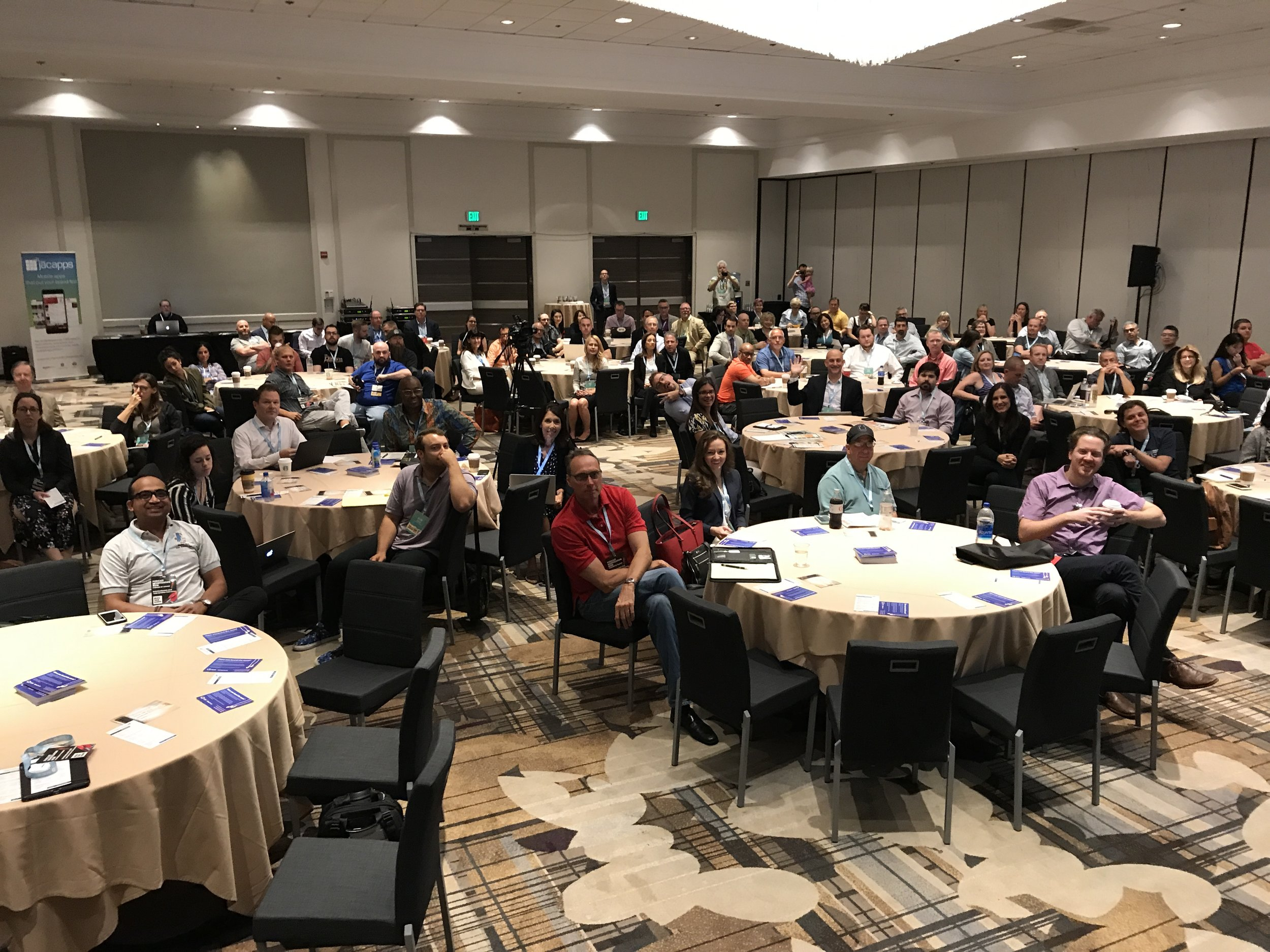 """A full room of radio people at Jacobs Media hosted """"Broadcasters Meets Podcasters"""" track"""