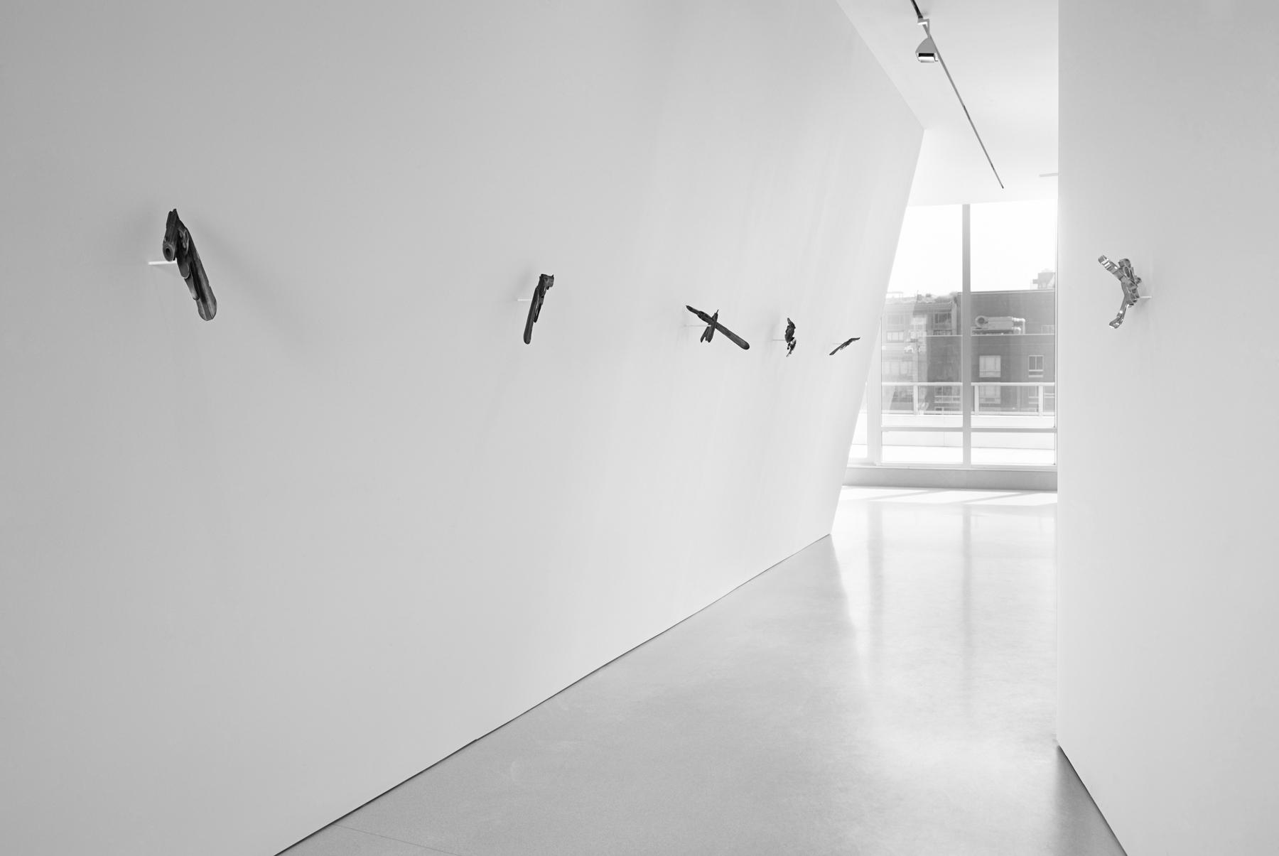 guns, knives, brass knuckles , installation view