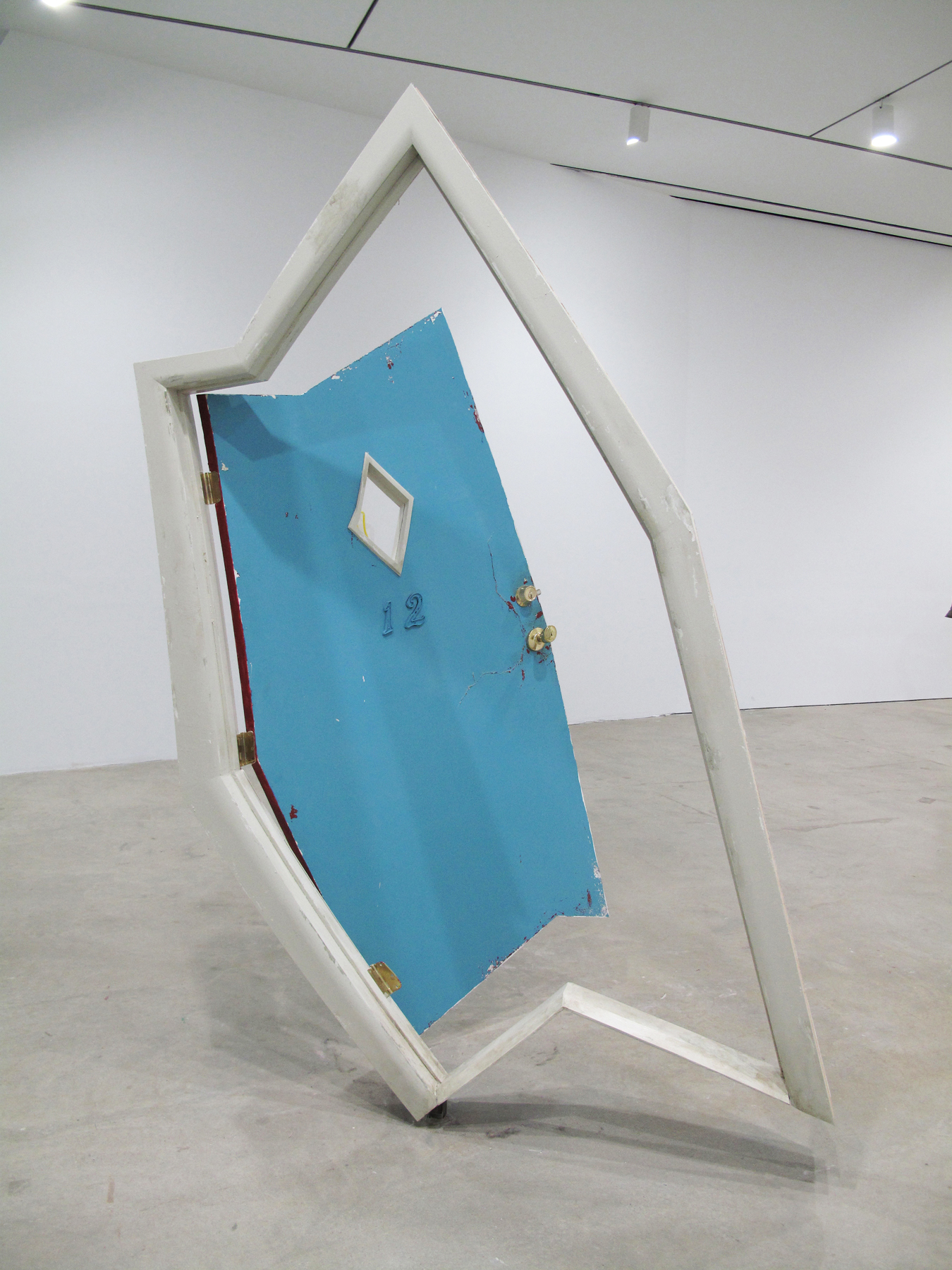 motel door  (kicked-in), 2012 wood, plexiglass and paint 102 x 70 x 48 inches