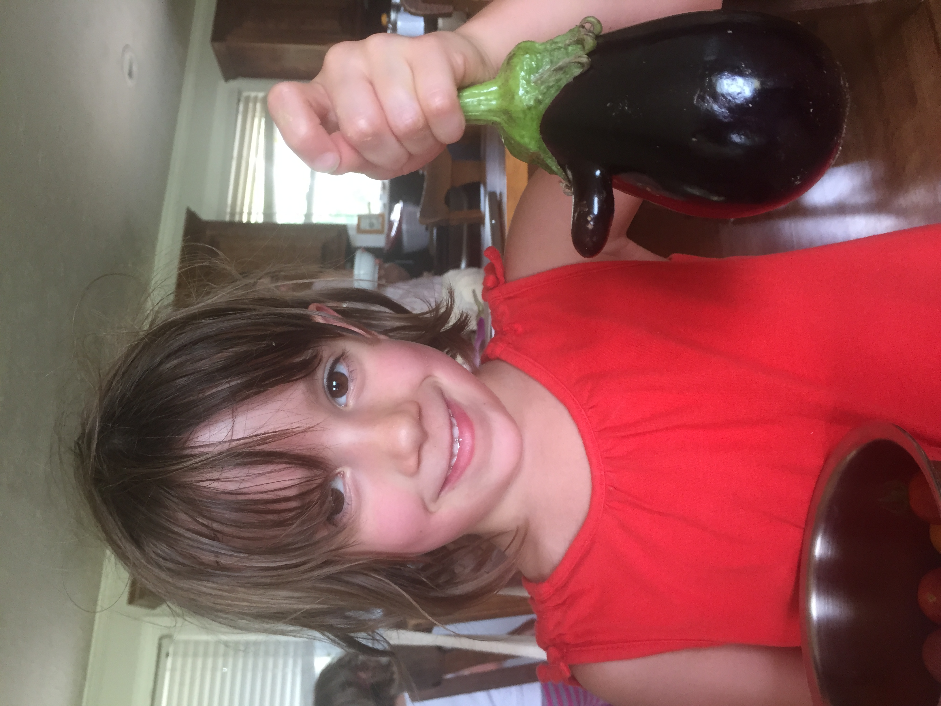 Lottie and other family members joined us for a Monday Father's Day Celebration/Family Work Party. Her eggplant has a nose! #best in-laws ever