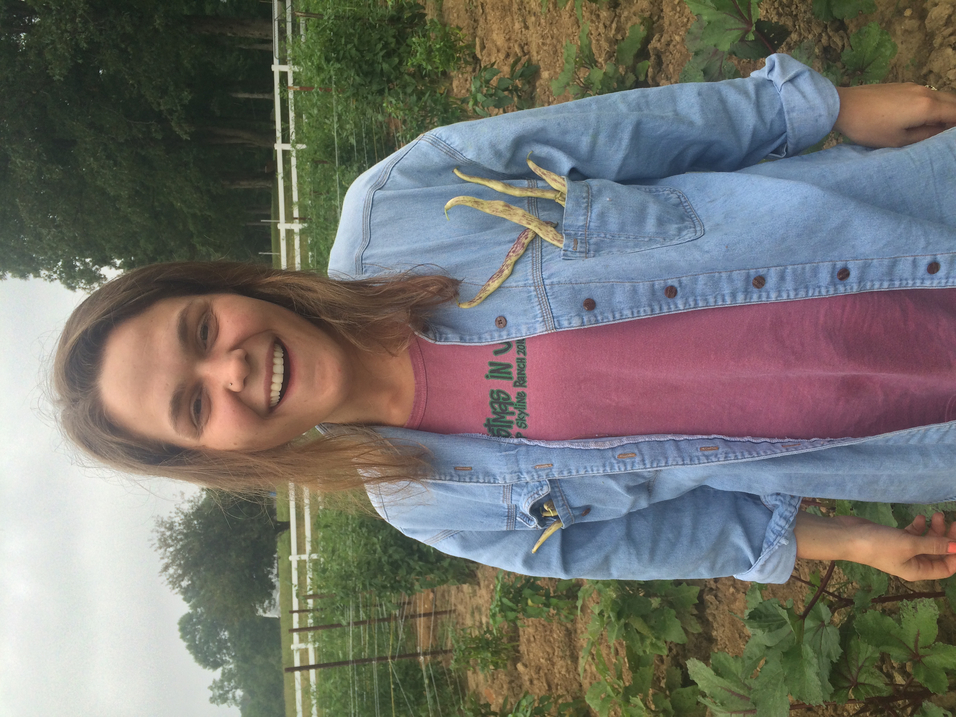 Cousin Sarah harvesting beans and putting em in her pocket!