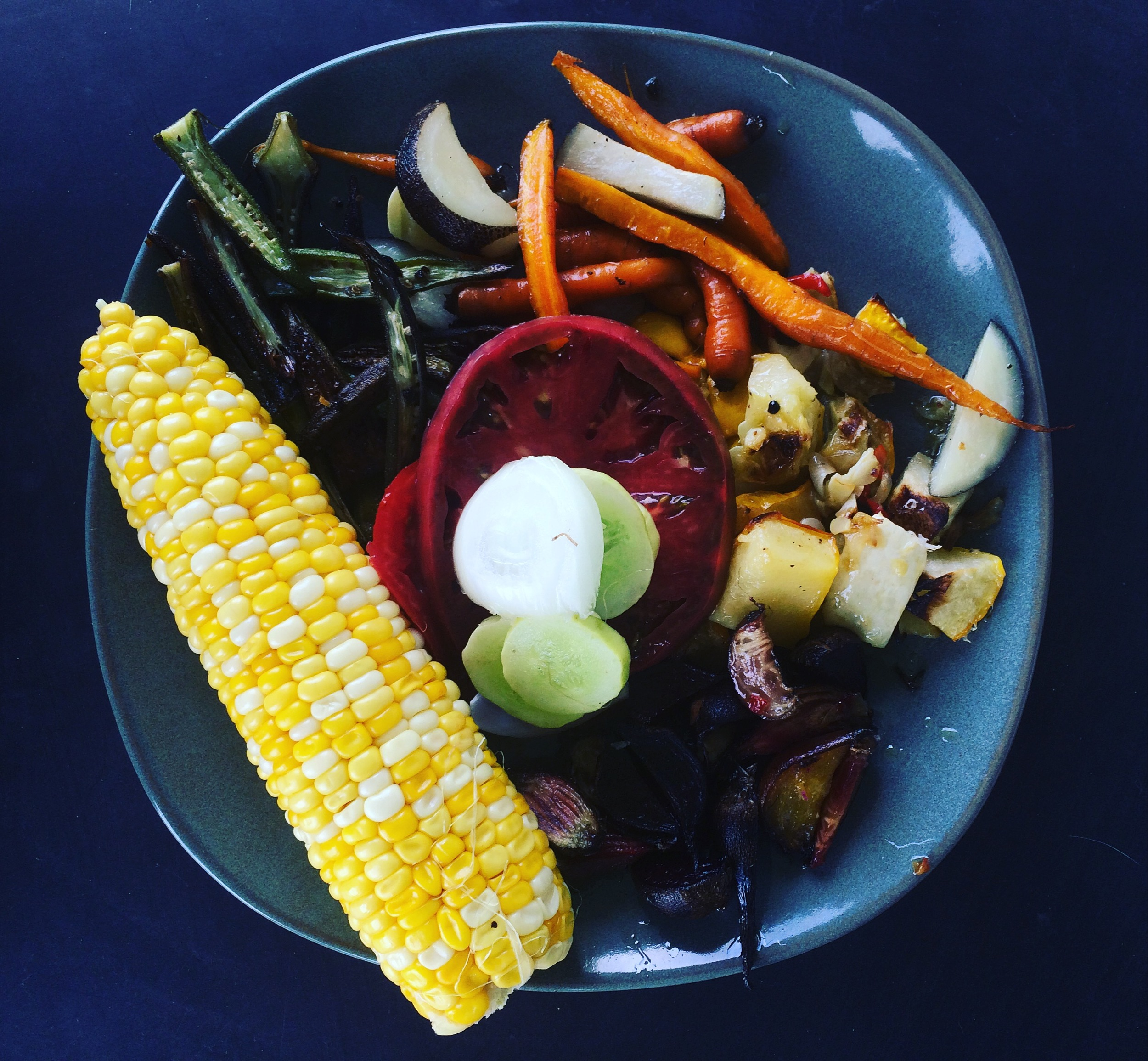 Lunch yesterday included corn on the cob, roasted okra, carrots and spanish black radish, peppers and squash, some of the last of the beets, and fresh sliced tomatoes, cucumbers and onion. It was amazing, thanks to my husband,
