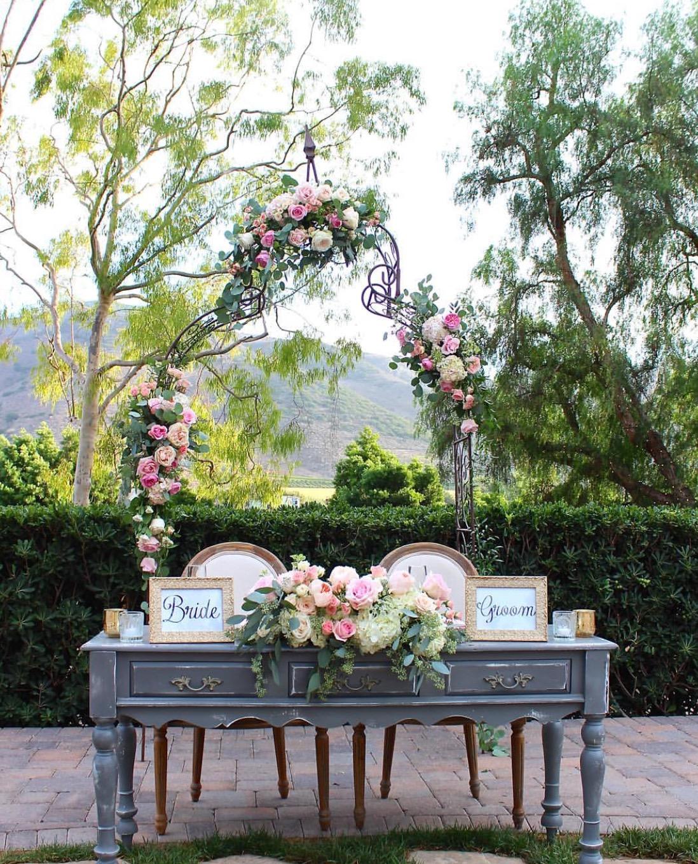 Arrangement by    Enchanted Garden Floral Design