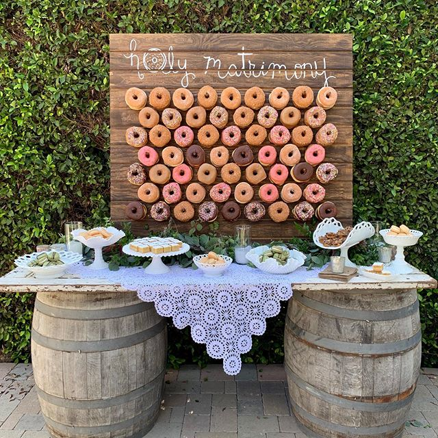 Holy Matrimony! @mjbcakes made our couple a custom donut wall. #wedding #weddingvenue #camarillo #venturacounty #gardenwedding #donut #donutwall #sweets #weddingbaker