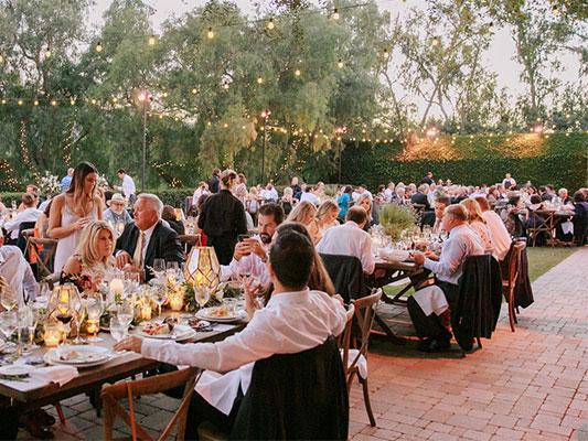 Guests in the beautiful gardens at the wedding venue near Santa Barbara.