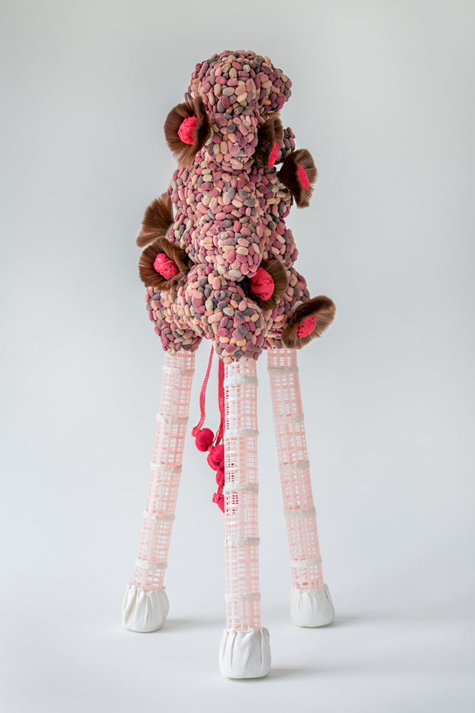 "On the twig of fortune  (2016) eye shadow applicators, lipstick, sponges, cosmetic face brushes, nail polish, placemat, hair curlers, silk slips 32"" x 18"" x 17"" * Title from the poem, Lament of a Worthless Woman, by Nazik al-Malaika."