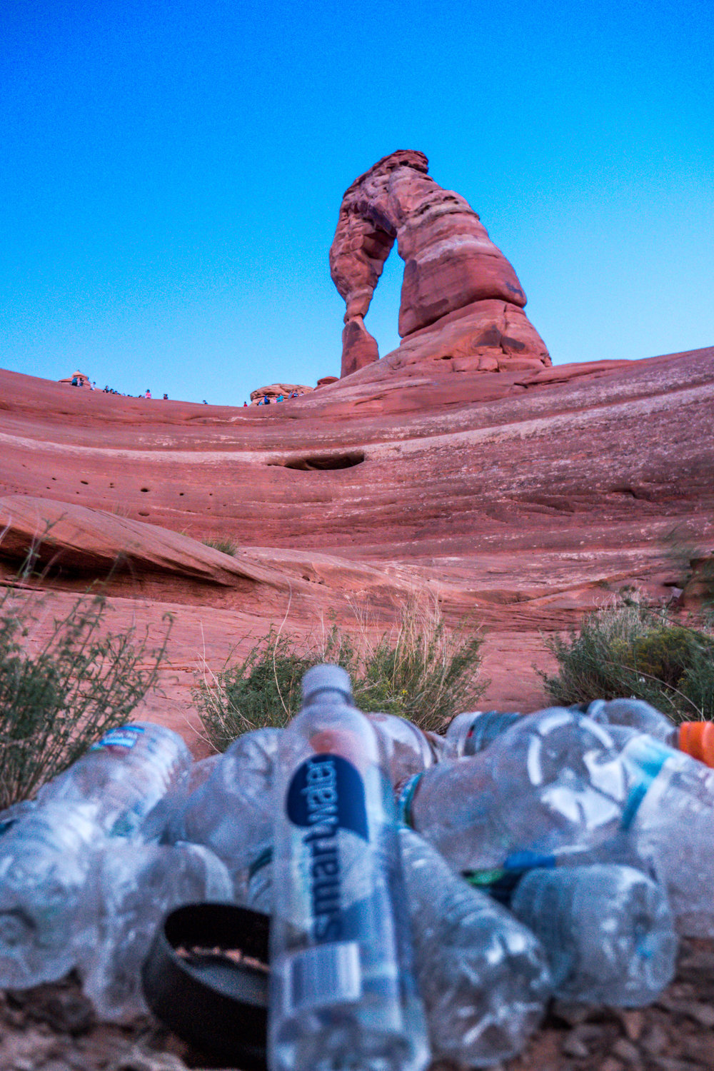 Over 40 bottles and other pieces of trash fell down below Delicate Arch in Arches National Park
