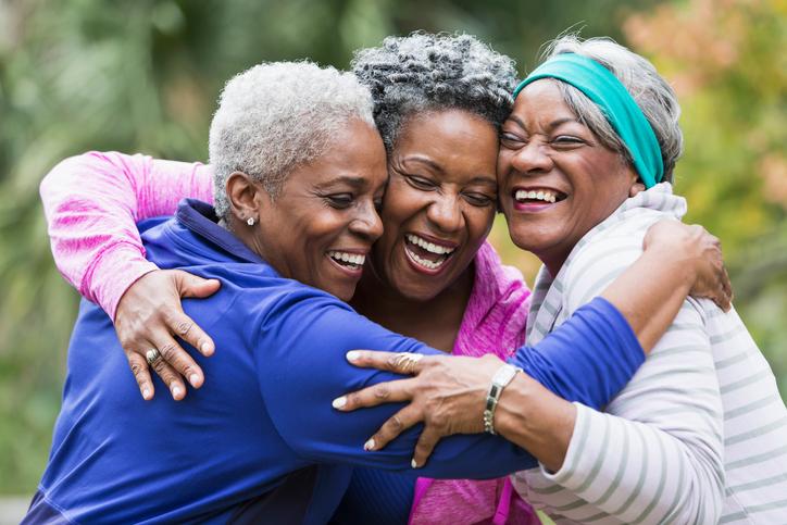 Women hugging friends -538650441.jpg