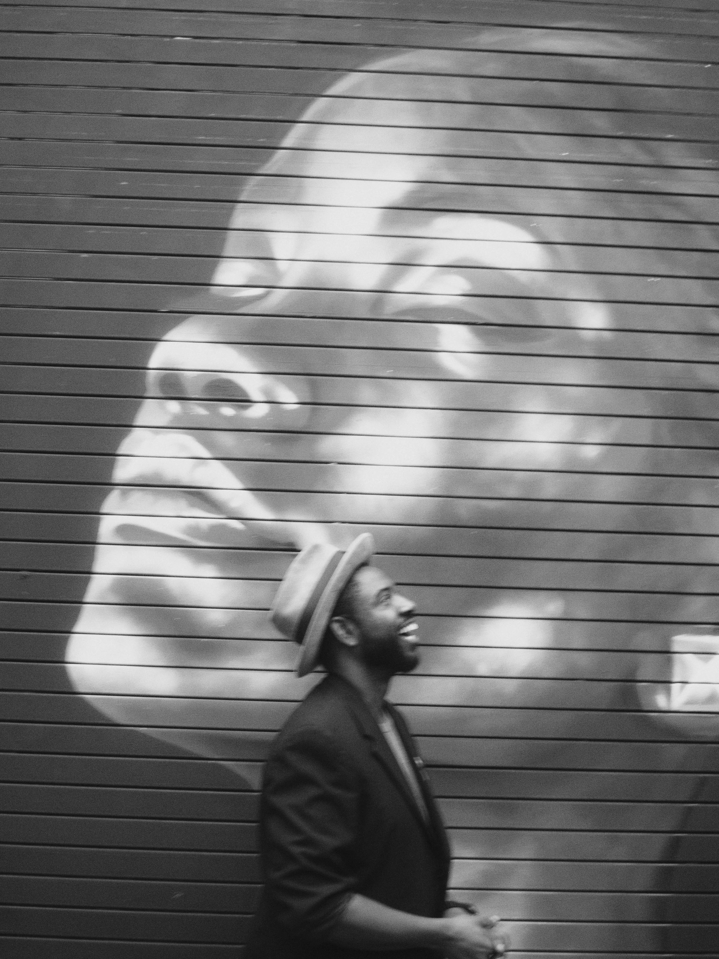 A trio of friends faces at once. Image of woman's face by Vek Neal, recreated as a mural by Brandon Sadler and Sean Fahie is just kinda in front of it : )