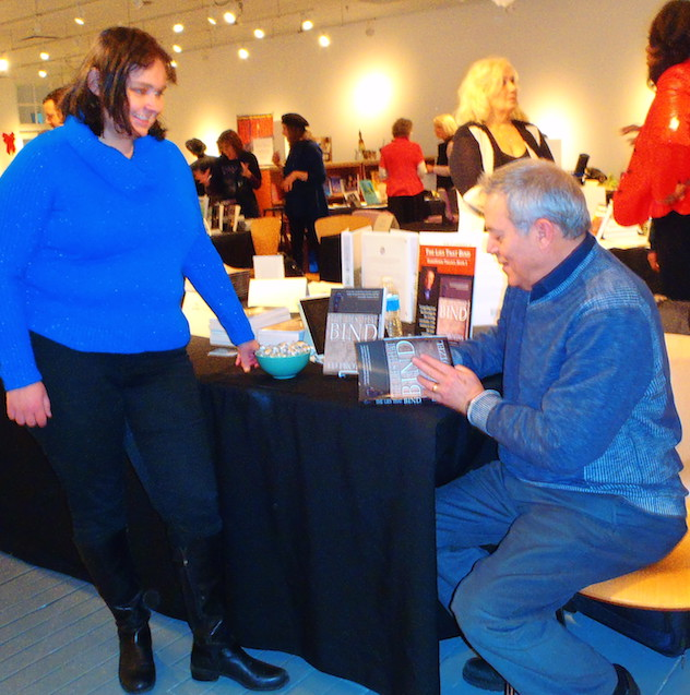 "Signing a copy of  The Lies That Bind  at today's ""extravaganza."""