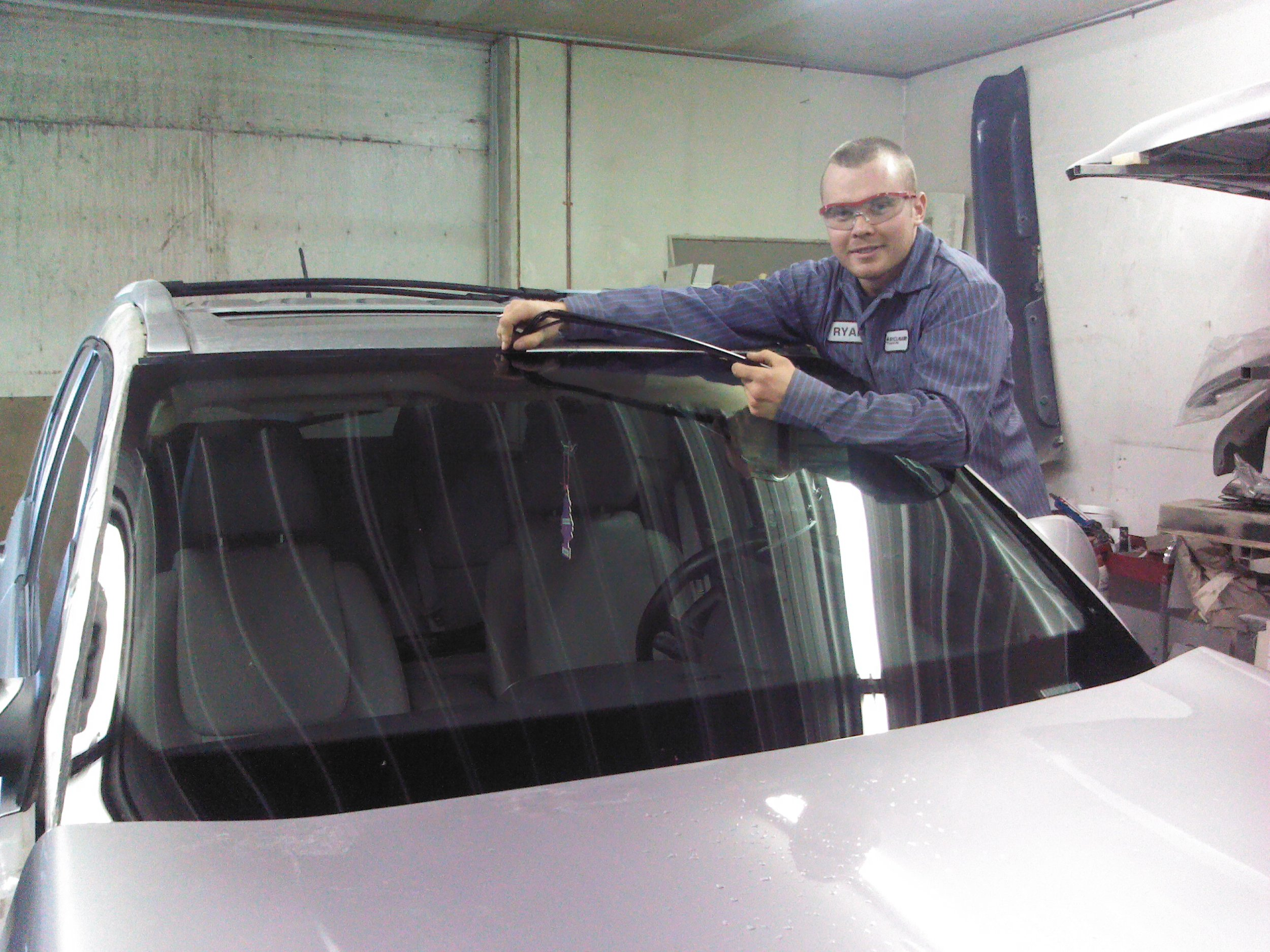 Ryan changing a windshield on a customers vehicle in our old shop in February of 2012.