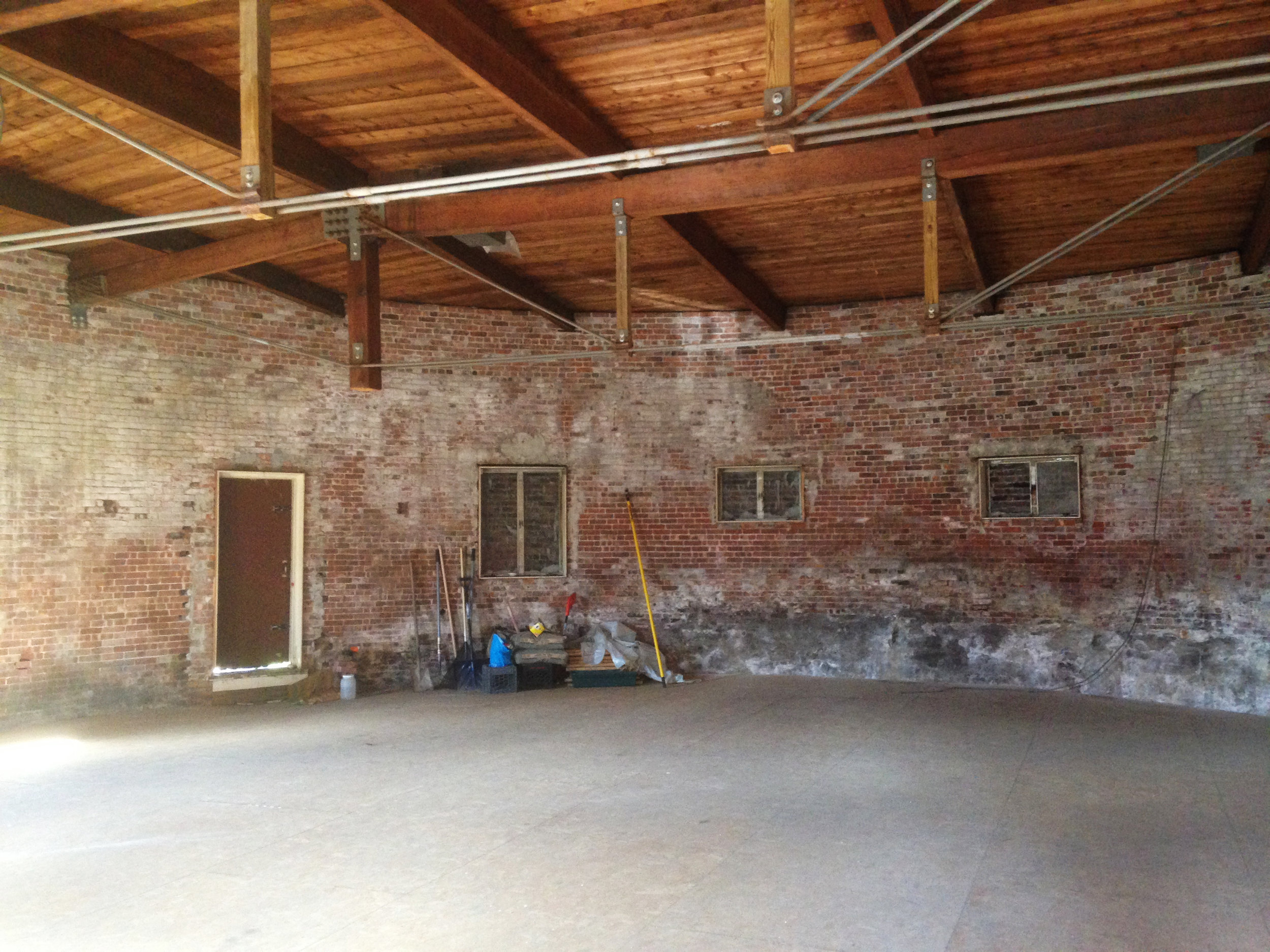 """One can see where a column was """"cut"""" short and restructured within a metal truss under the ceiling to create a completely open circular floor plan"""