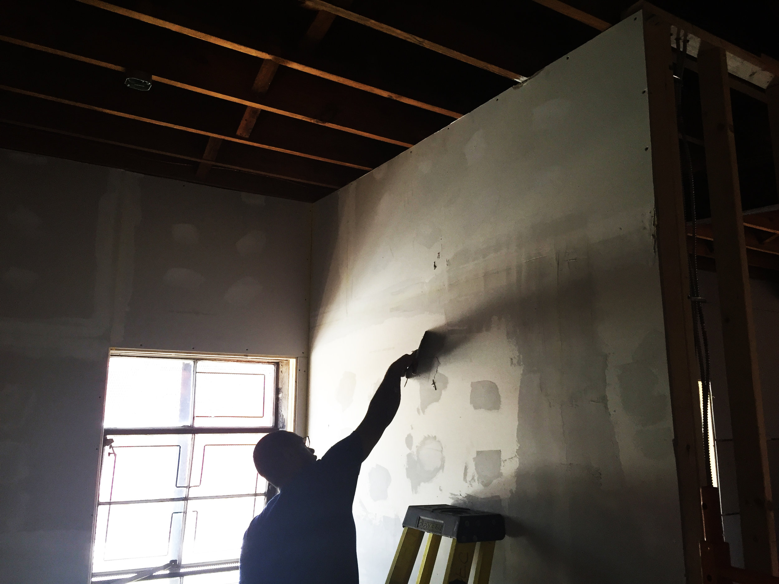 Mark, preparing a wall for its finishes