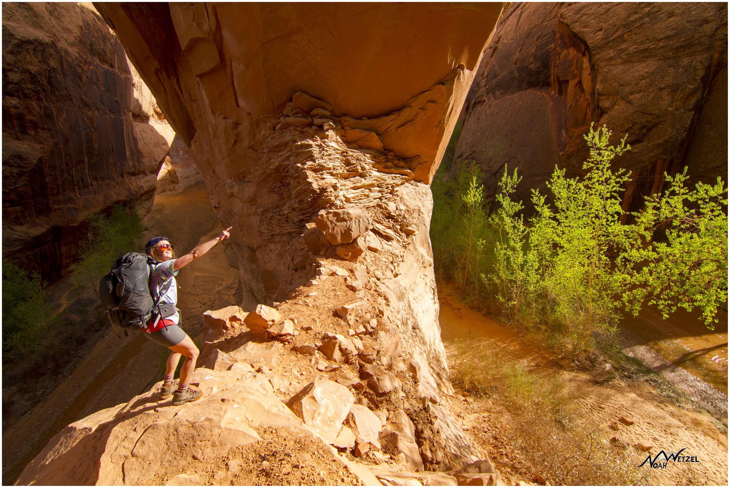 Kelsey underneath Jacob Hamblin Arch. Coyote Gulch. Escalante, Utah