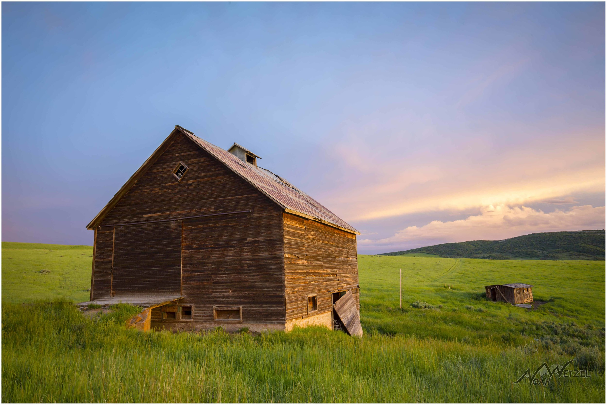 Face in Coulds. Barn Sunset. 20 Mile Road. Steamboat Springs, Colorado