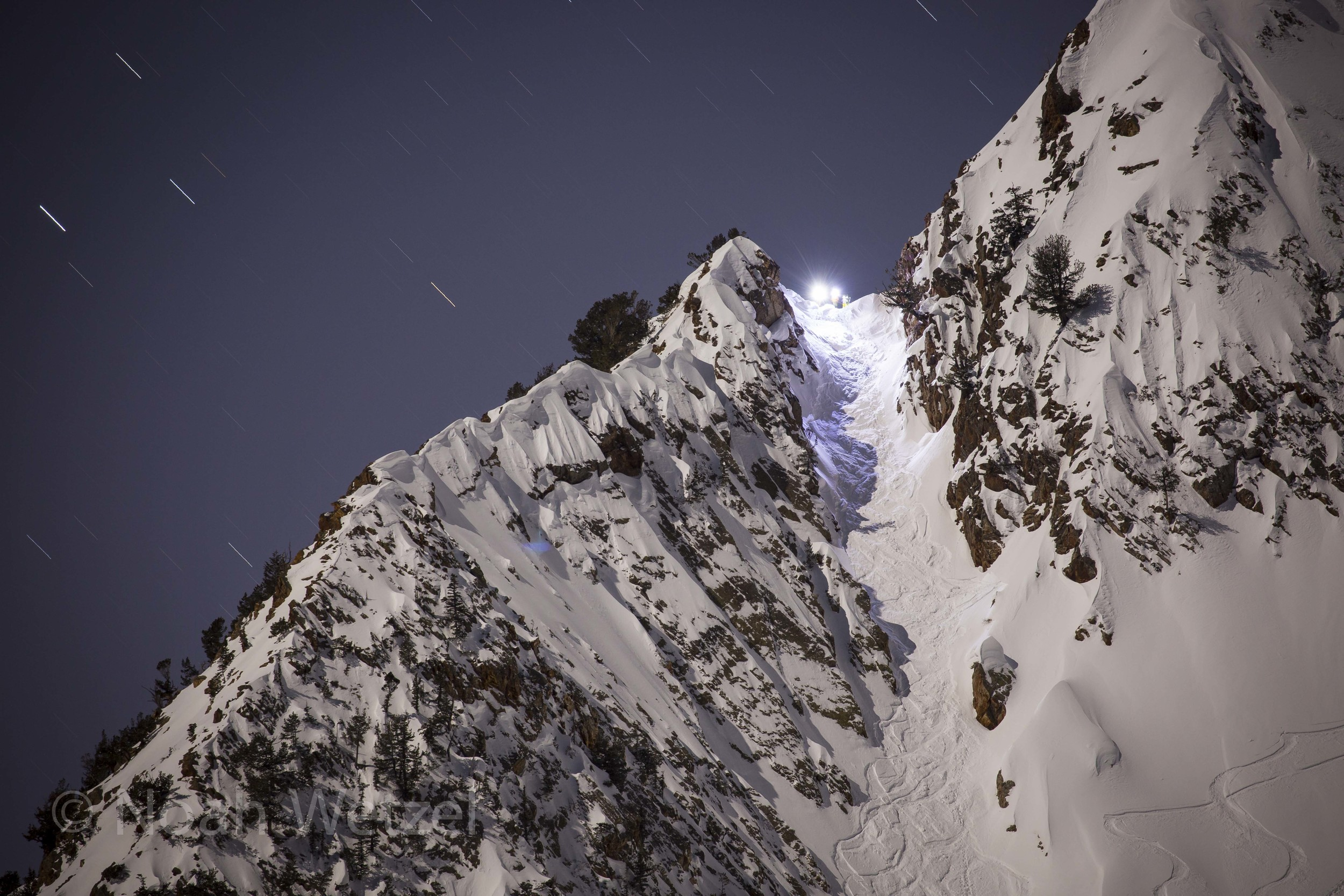 Willie Nelson, Chris Brule, and Lucy Sackbauer standing atop Suicide Chute. Full Moon Skiing. Day 2  12:30am