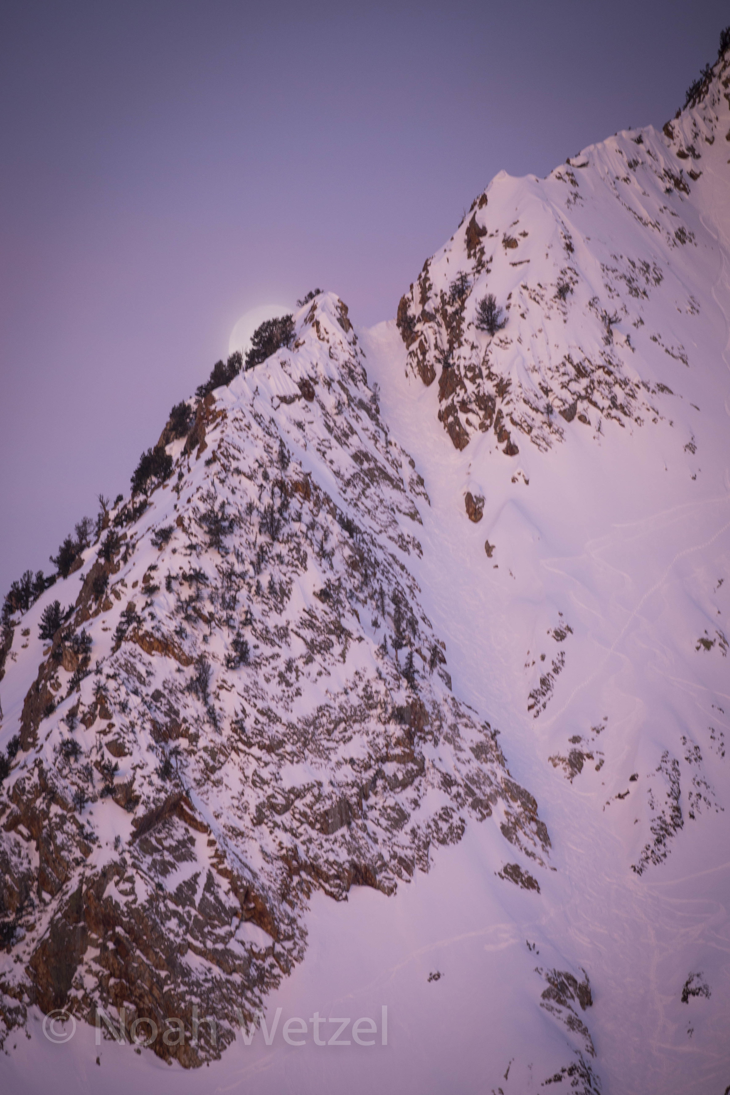Sunrise with the Moon setting behind Suicide Chute on the morning of Day 2. Ski City Shootout. Snowbird, Utah.