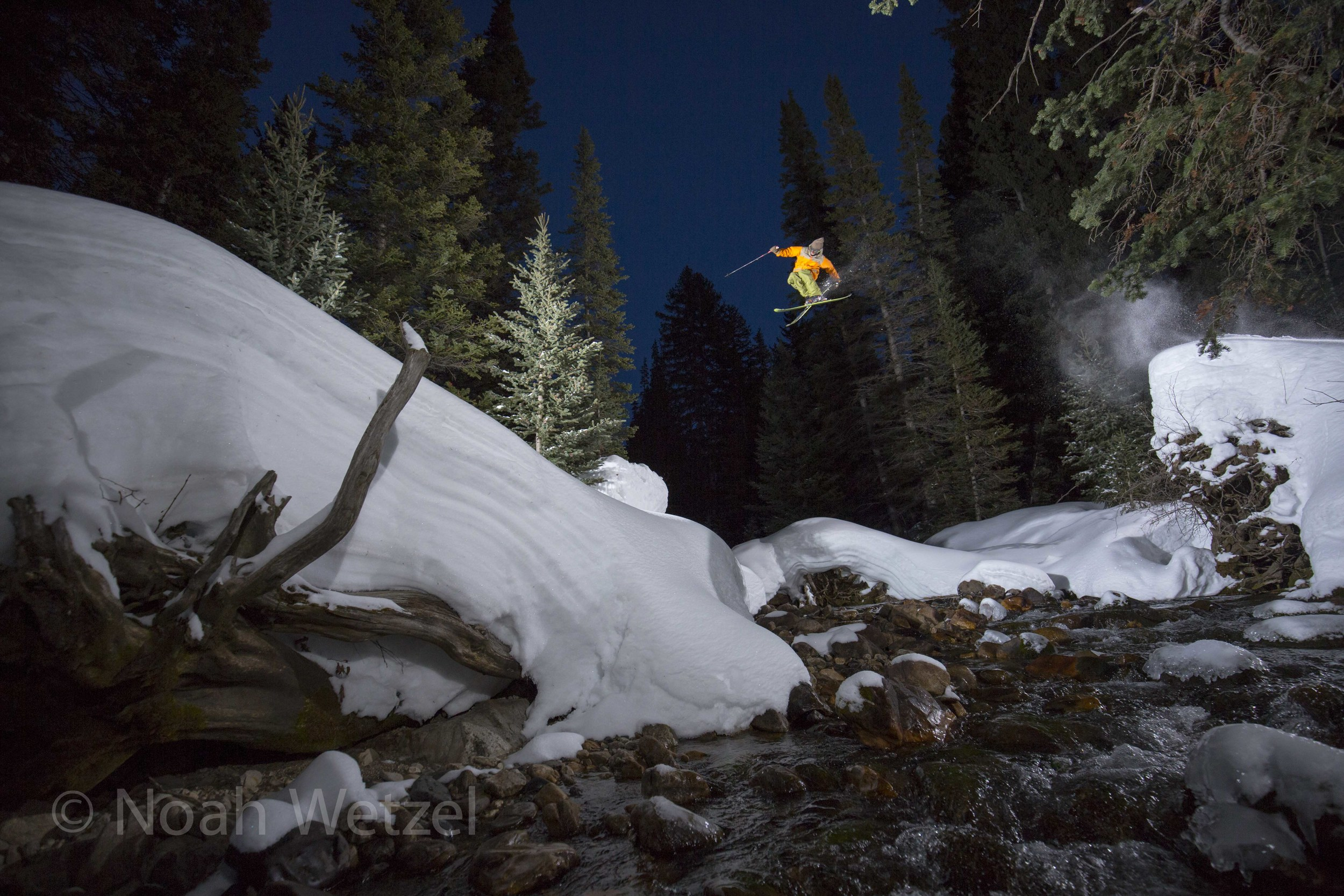 Willie Nelson floating a 180 tail grab over the Snowbird Resort creek gap. Day 2.