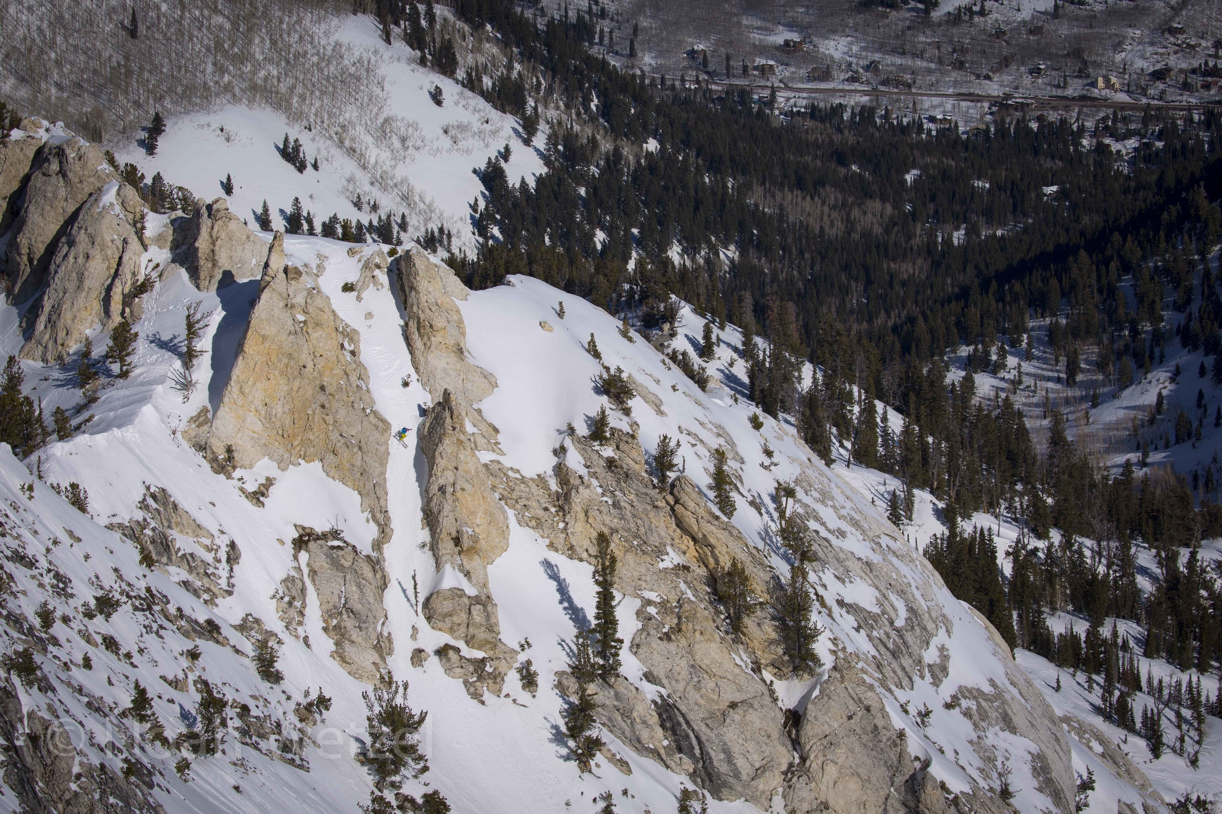 Lucy Sackbauer skiing a tight chute on Fantasy Ridge at Solitude Mountain Resort. Day 3