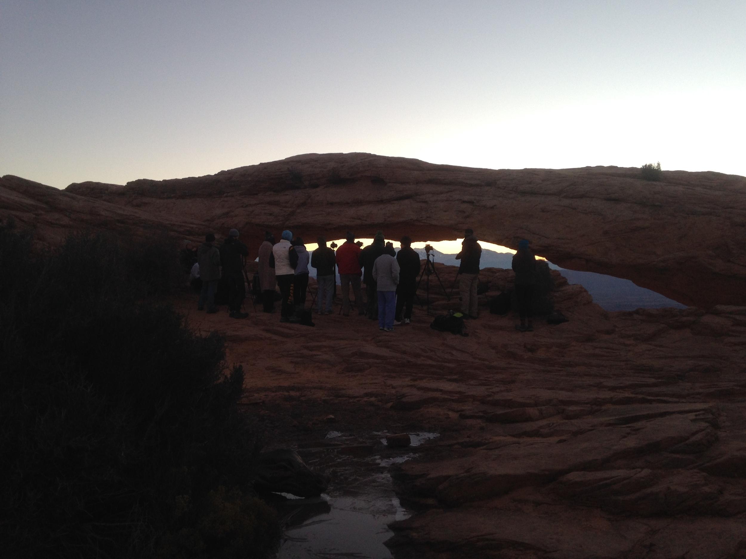 Photographers Shoulder to Shoulder at Mesa Arch Sunrise