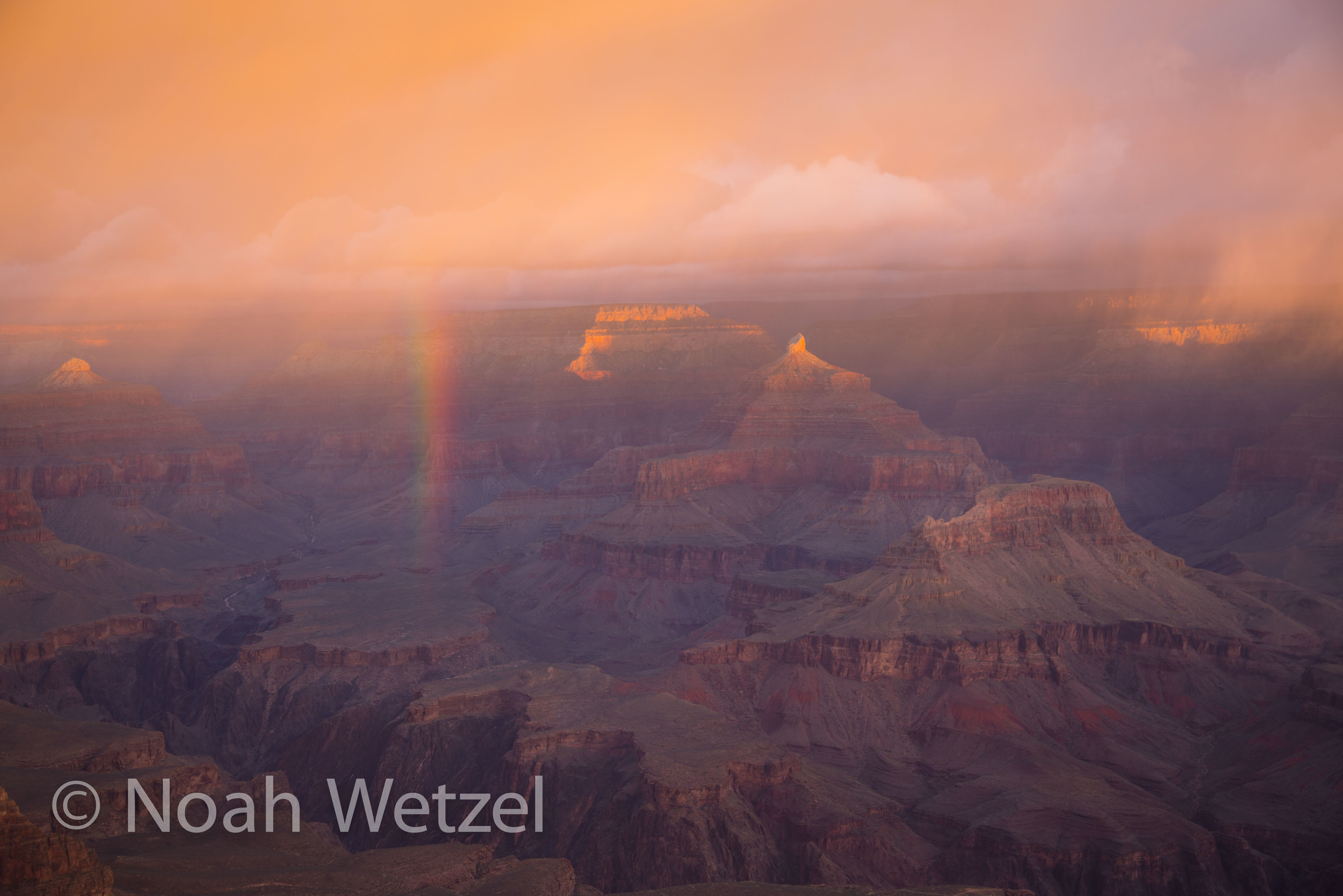 First light illuminating a rainbow in Grand Canyon National Park, Arizona.