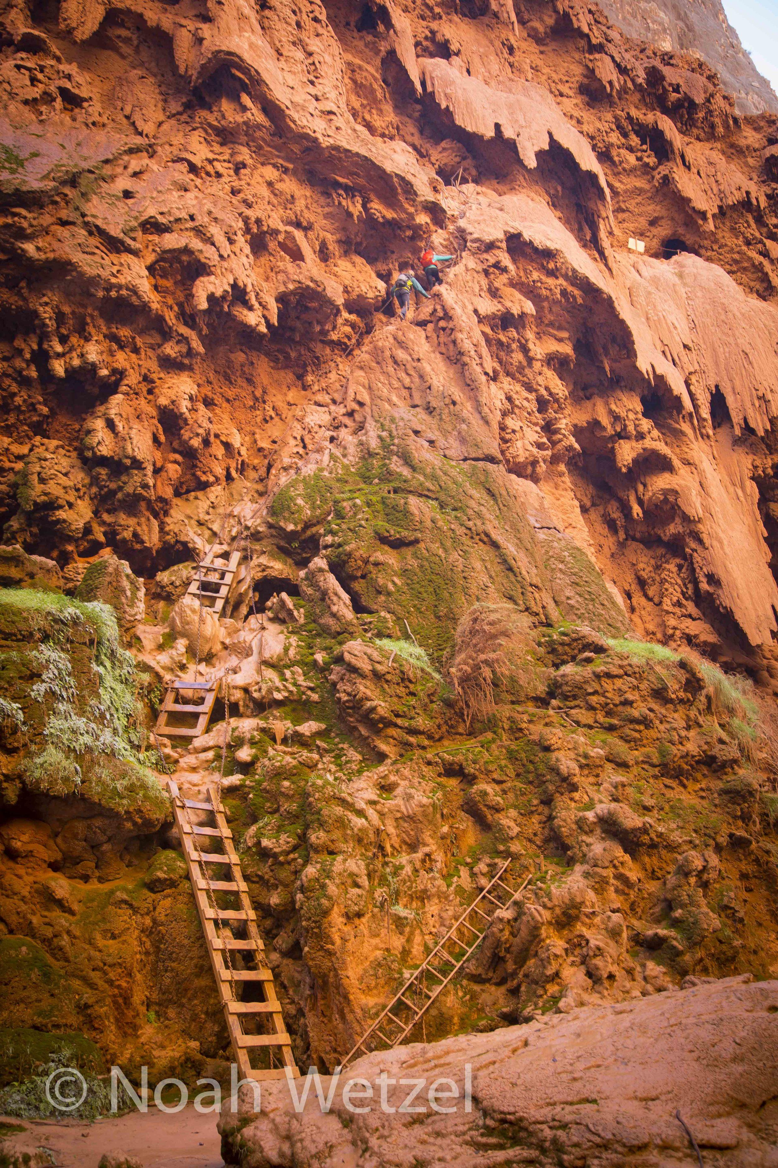 Rachel and Jerome ascend the Indiana Jones ladders at Mooney Falls. Supai, Arizona