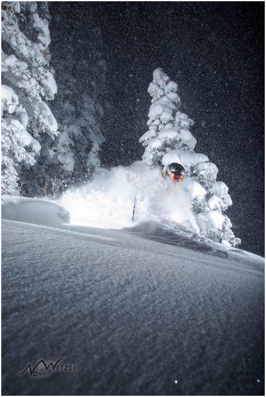Chris Brule blows up a turn at night in Westward Ho at Alta Ski Area, Utah.