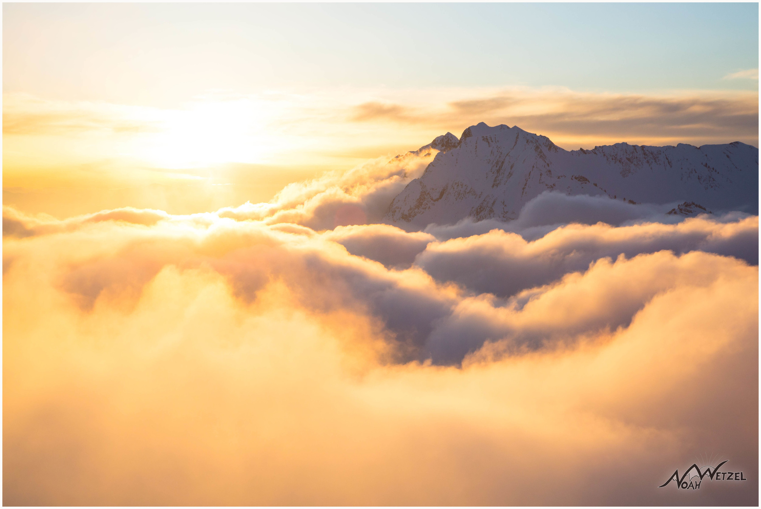 Mt. Superior floats amongst a sea of clouds in a truly surreal sunset in Little Cottonwood Canyon, Utah.