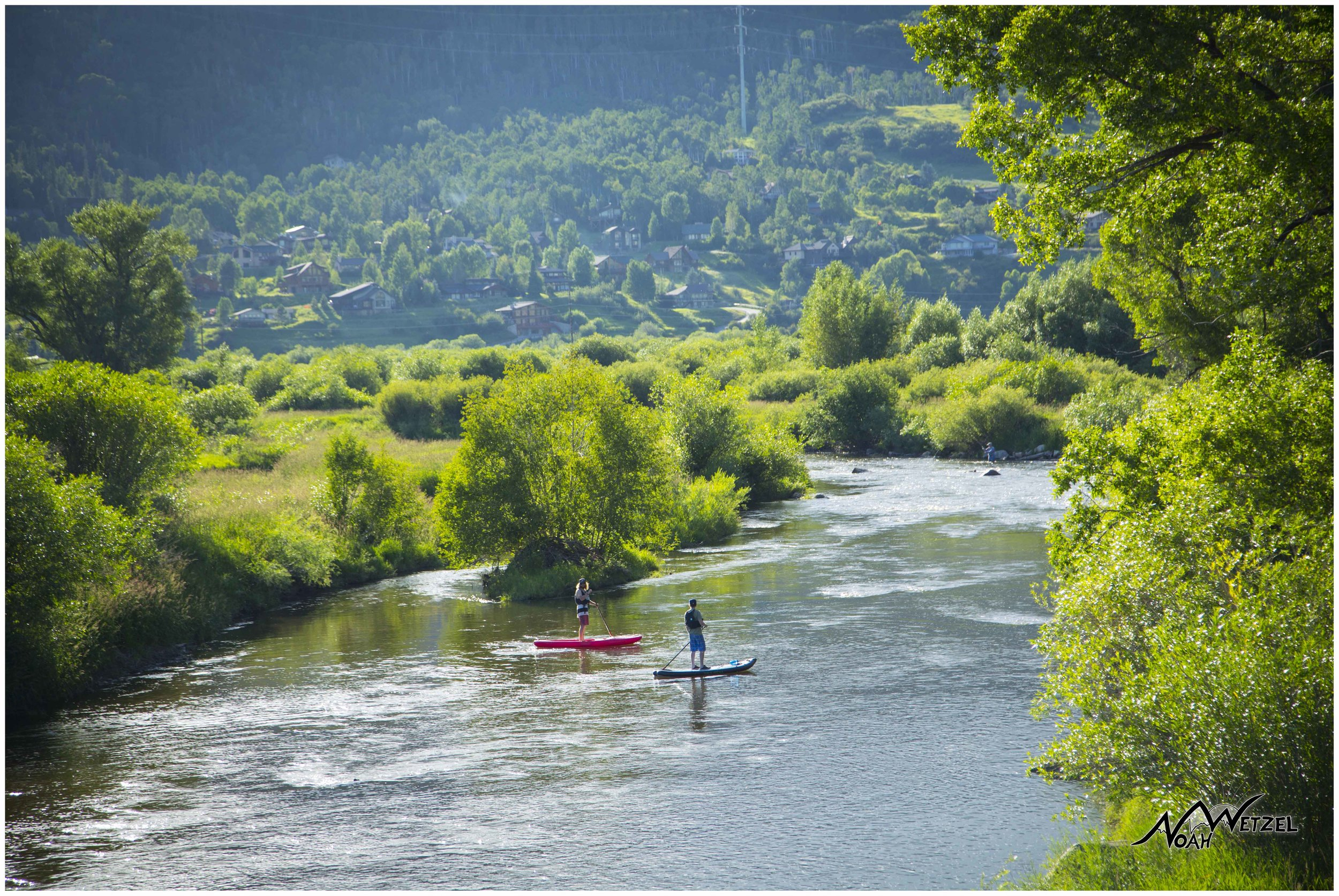 Mike Rundle and Marty Smith paddle-boarding the Yampa River. Colorado