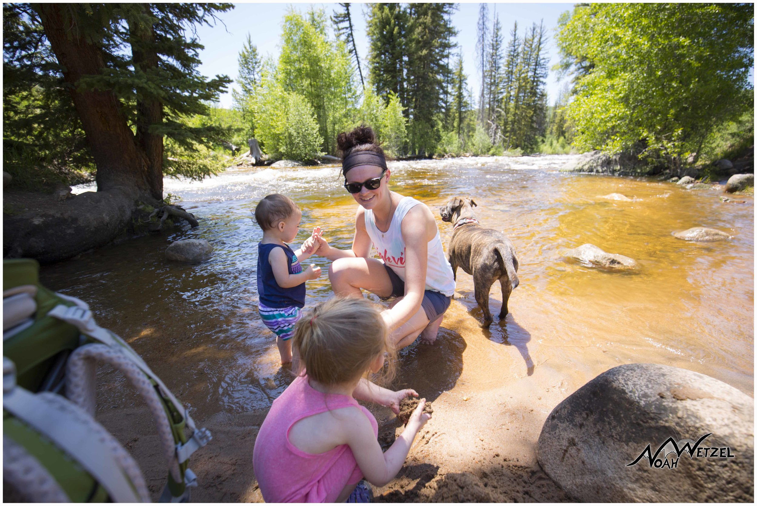 Keasha Speidel and her daughters Nevaeh and Tinley cool off near the Mad Creek Barn.